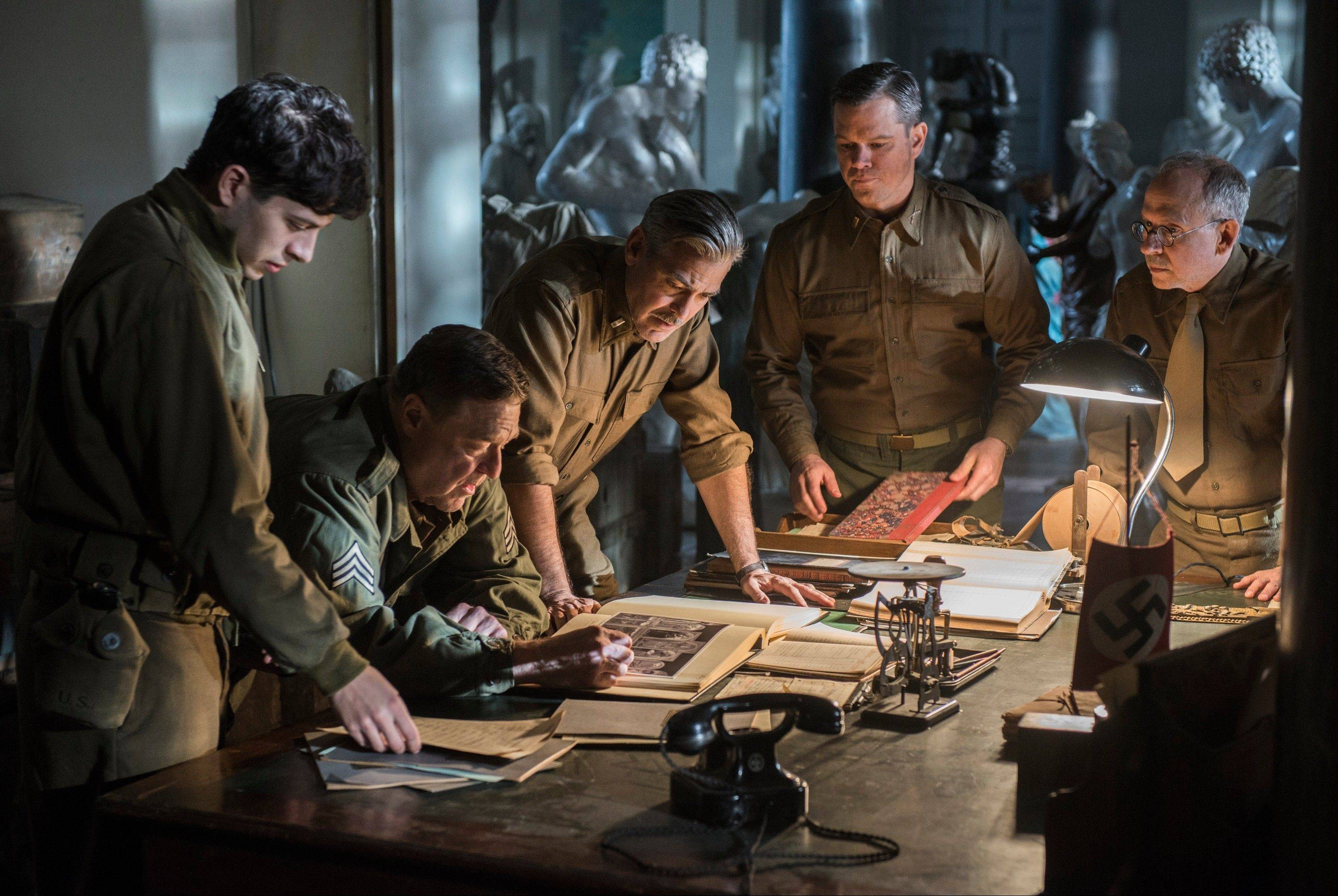 "This image released by Columbia Pictures shows, from left, Dimitri Leonidas, John Goodman, George Clooney, Matt Damon and Bob Balaban in ""The Monuments Men."""