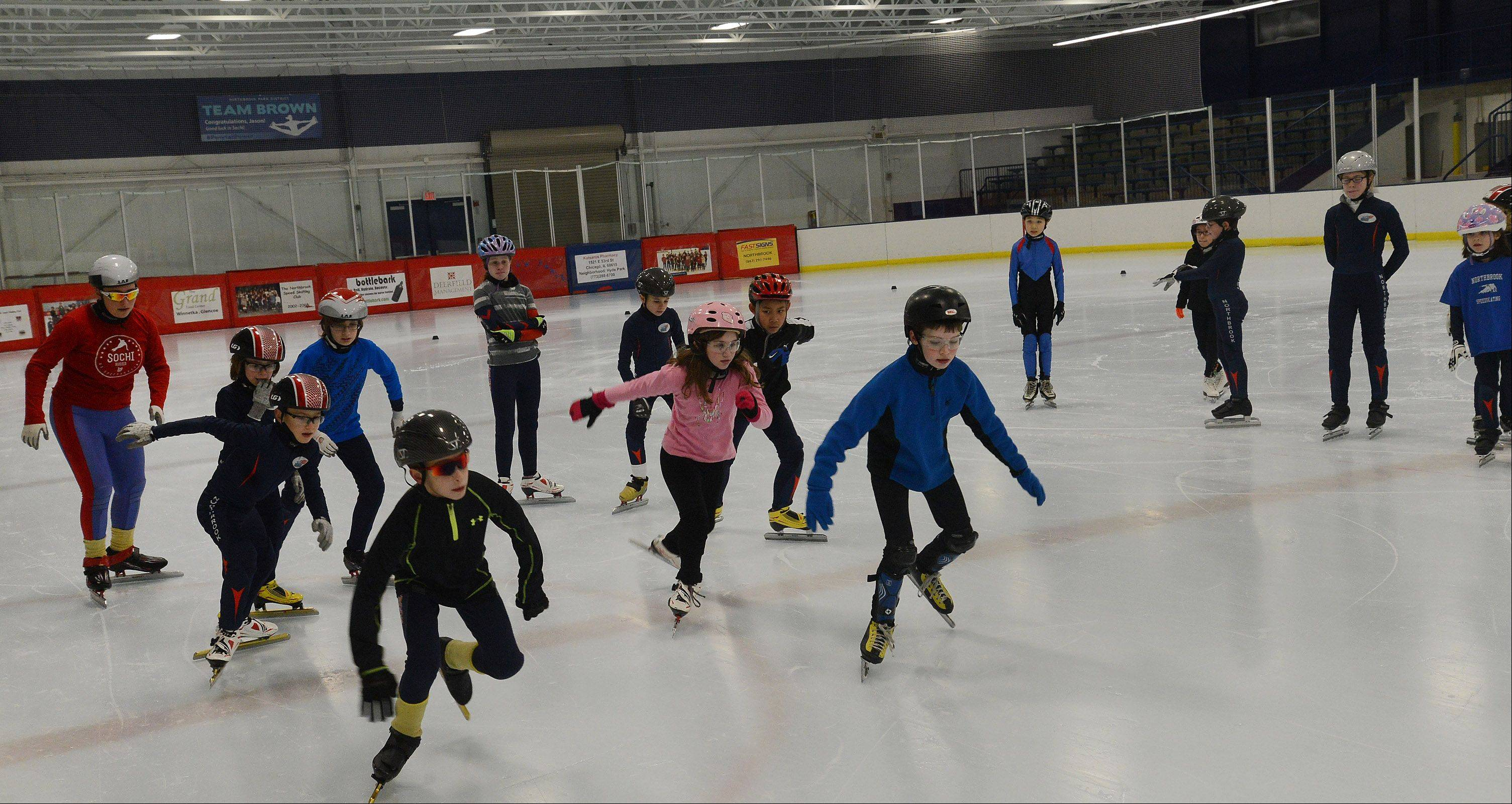 Members of the Northbrook Speed Skating Club take to the ice during one of its practices. The club's alumni include 19 Olympians, who won a combined 12 medals.