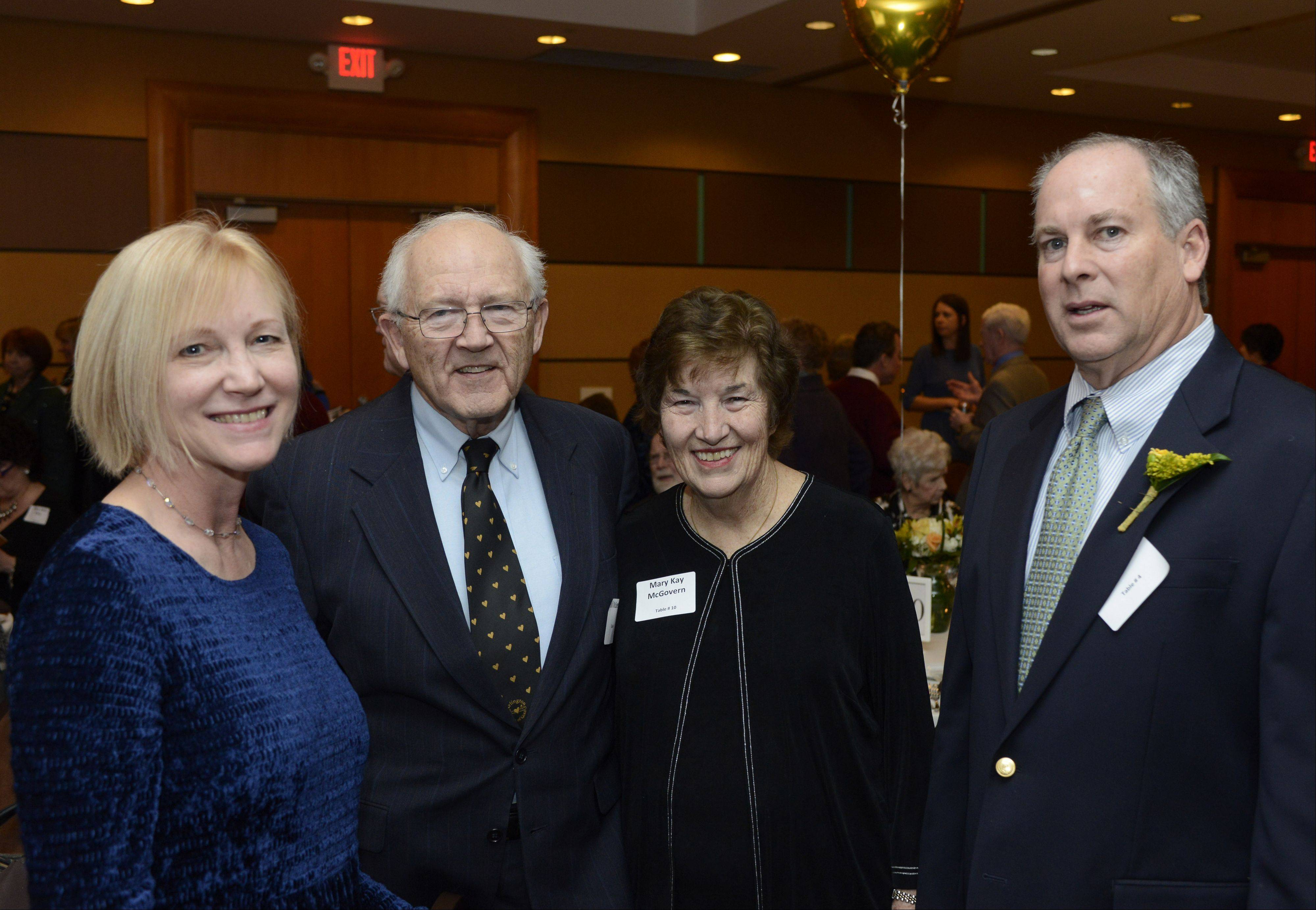 Amy Sanecki, left, and her husband, Jim, right, winner of the Mentor Heart of Gold award, with their friends Mary Kay and Bill McGovern, during Arlington Heights' 15th annual Hearts of Gold dinner Saturday night. Sanecki was honored for helping students learn the trades while conducting renovation projects for seniors.