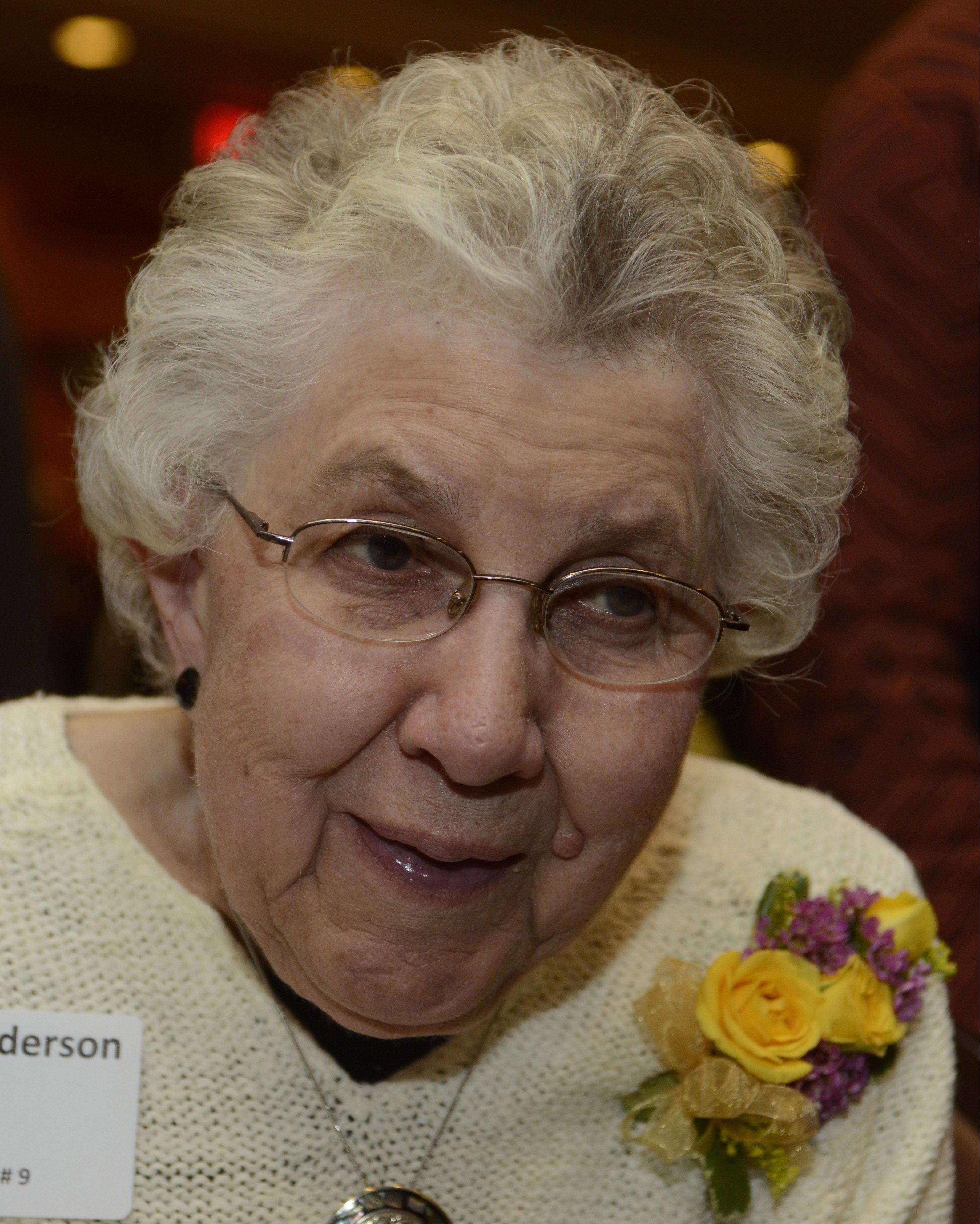 JOE LEWNARD/jlewnard@dailyherald.comLois Anderson received the Best Neighbor Award during Arlington Heights' 15th annual Hearts of Gold dinner Saturday night. Anderson was recognized for helping homebound seniors and assisting at a local homeless shelter.