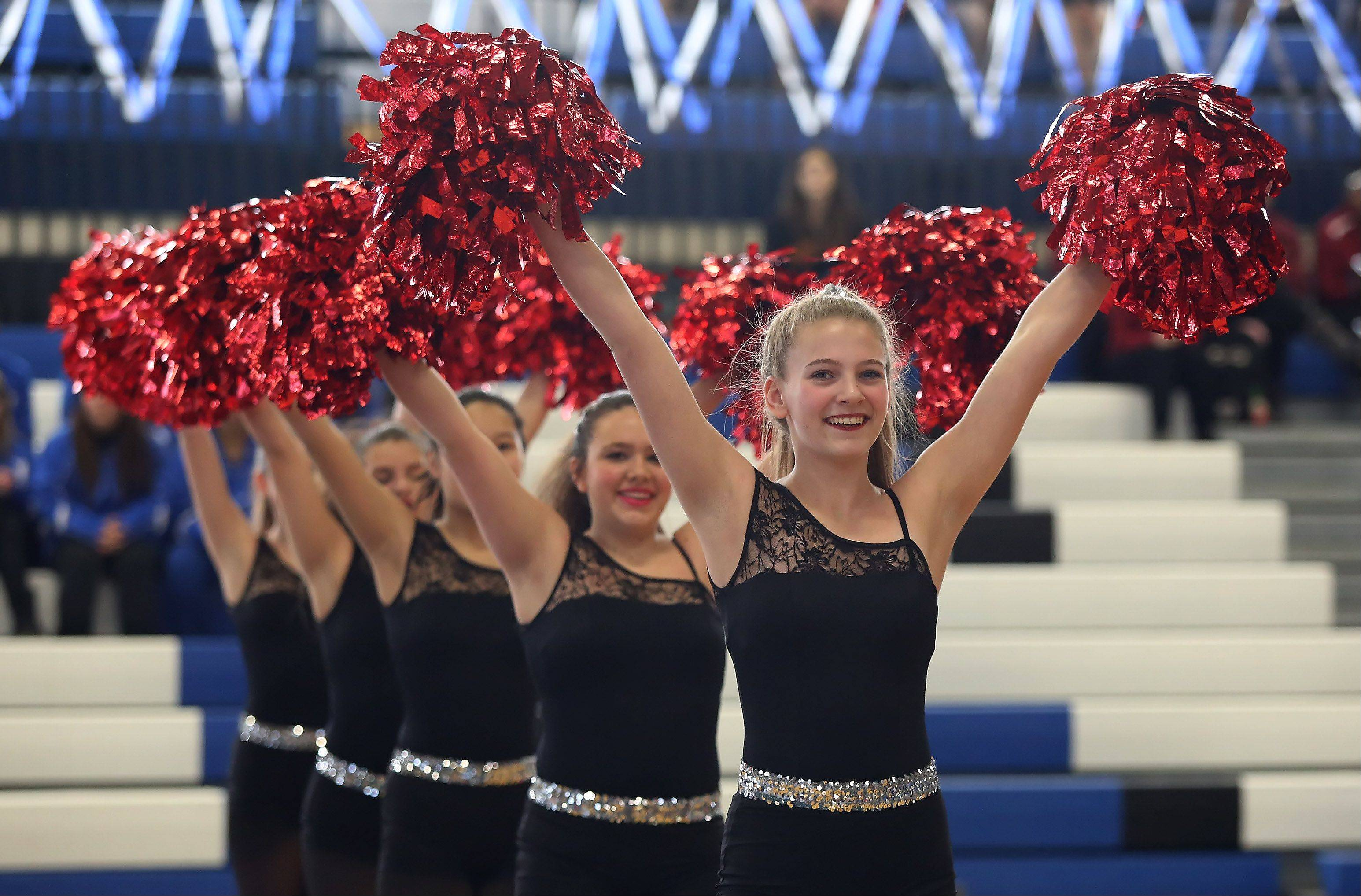 Lauren Savage, right, and the Plum Grove Junior High School of Rolling Meadows performs in the Junior High Pom division at the Illinois Drill Team Association regional competition Sunday at Maine East High School.