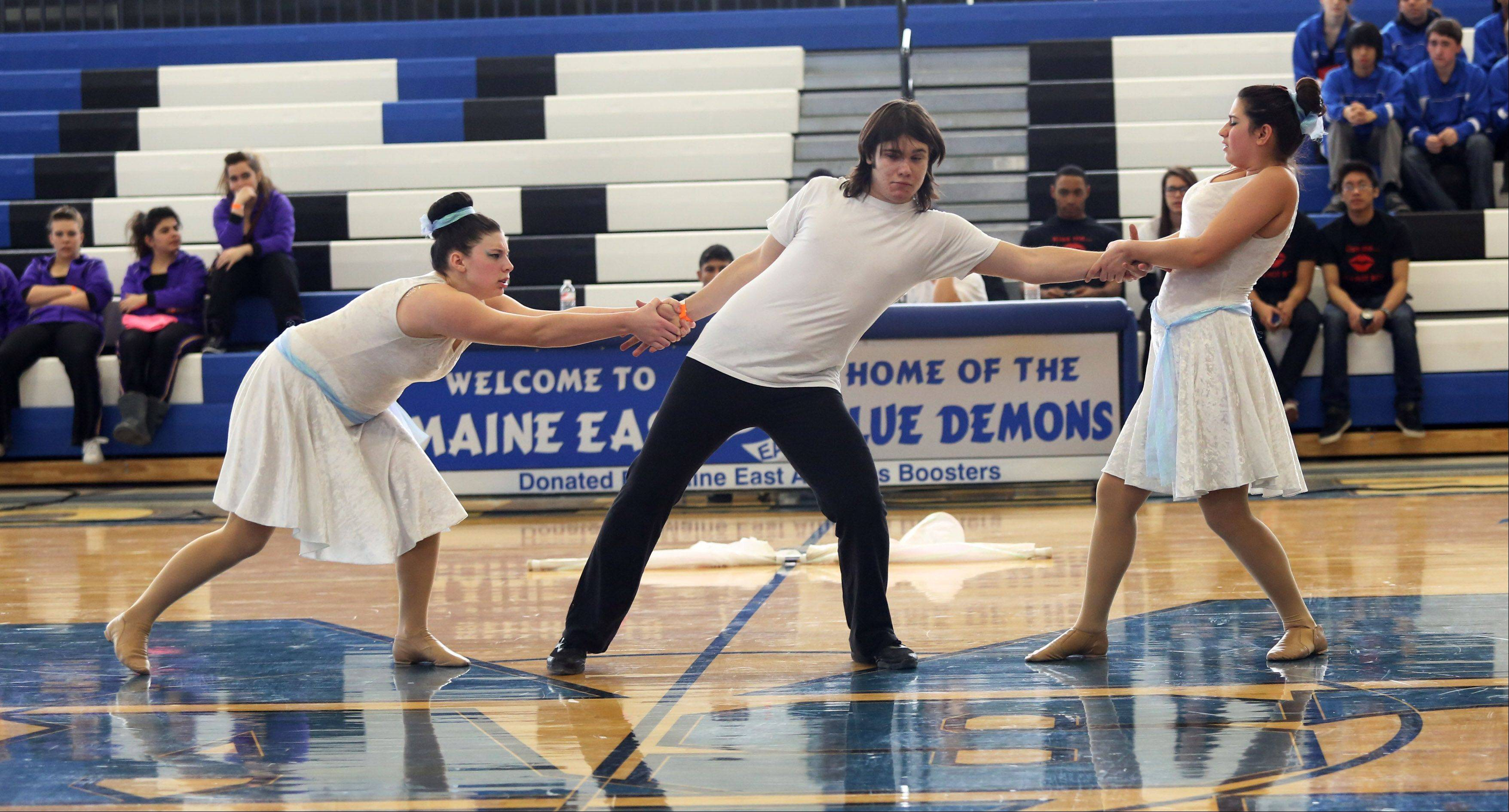 The St. Charles East High School junior varsity team performs in the Lyrical Flag division at the Illinois Drill Team Association regional competition Sunday at Maine East High School.