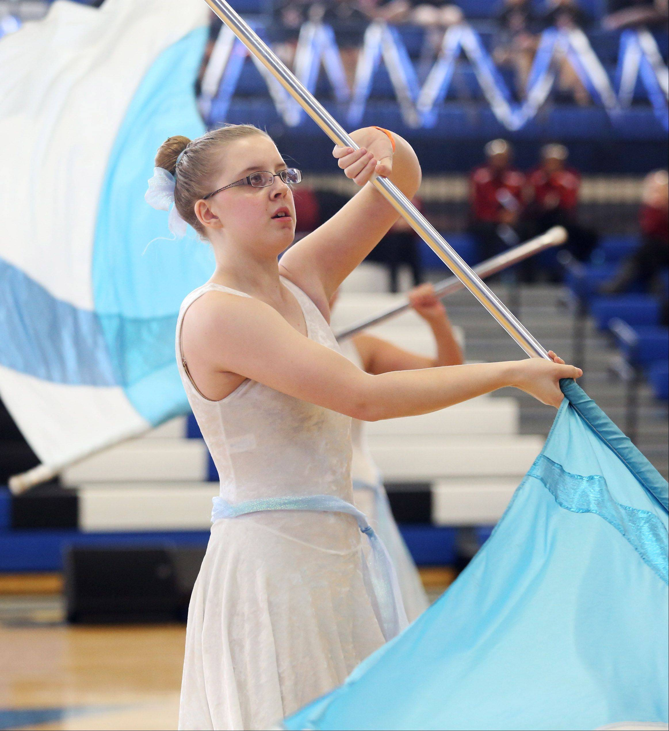 Cori Kirsininkas and the St. Charles East High School junior varsity team performs in the Lyrical Flag division at the Illinois Drill Team Association regional competition Sunday at Maine East High School.