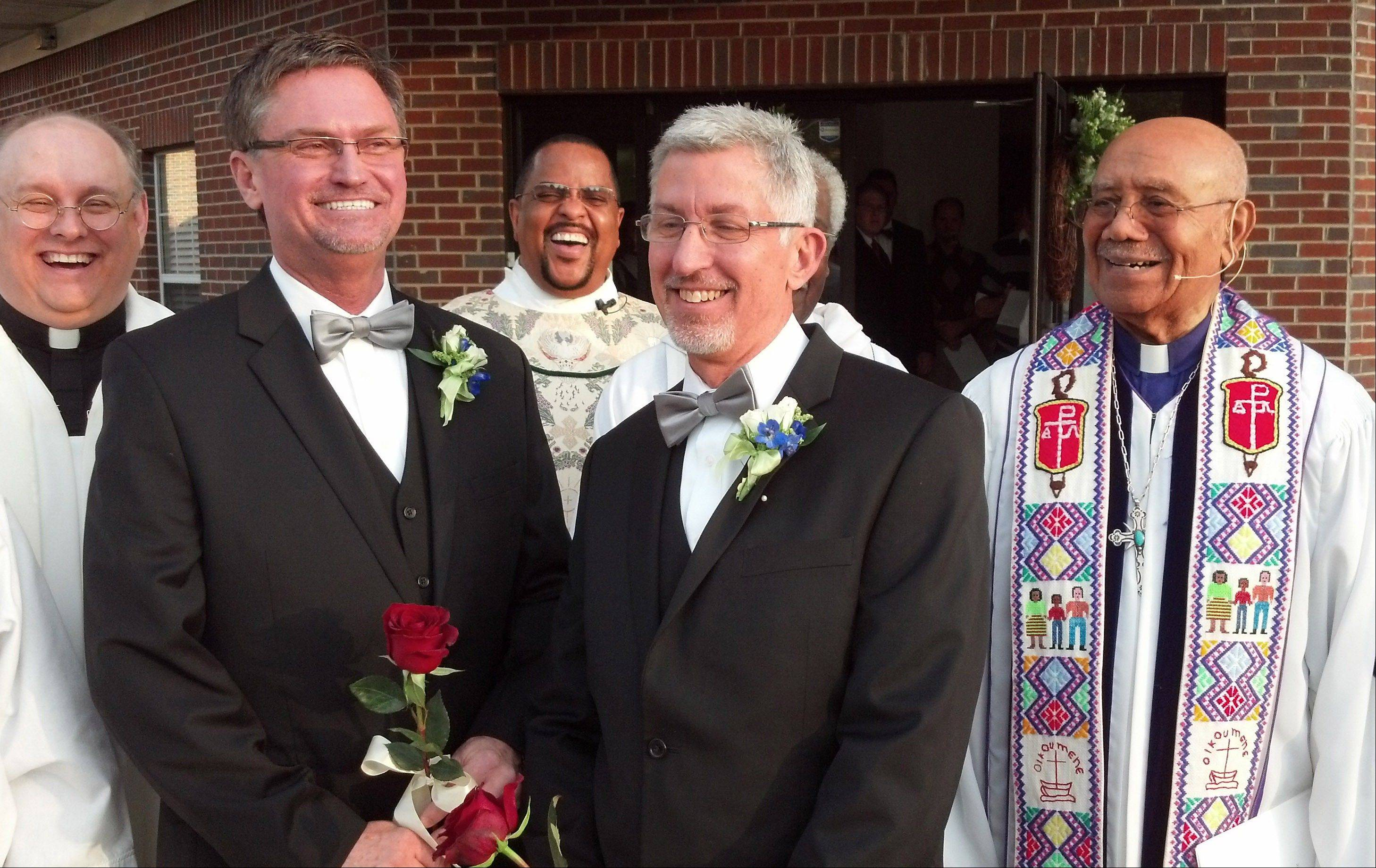 From left, the Rev. Kevin Higgs, Bobby Prince, the Rev. J.R. Finney, Joe Openshaw and retired Bishop Melvin Talbert stand together after Talbert officiated Prince and Openshaw's wedding in Birmingham, Ala. on Saturday, Oct. 26, 2013. The Council of Bishops has called for a formal complaint against Talbert, who presided at the wedding over the objections of a local bishop.
