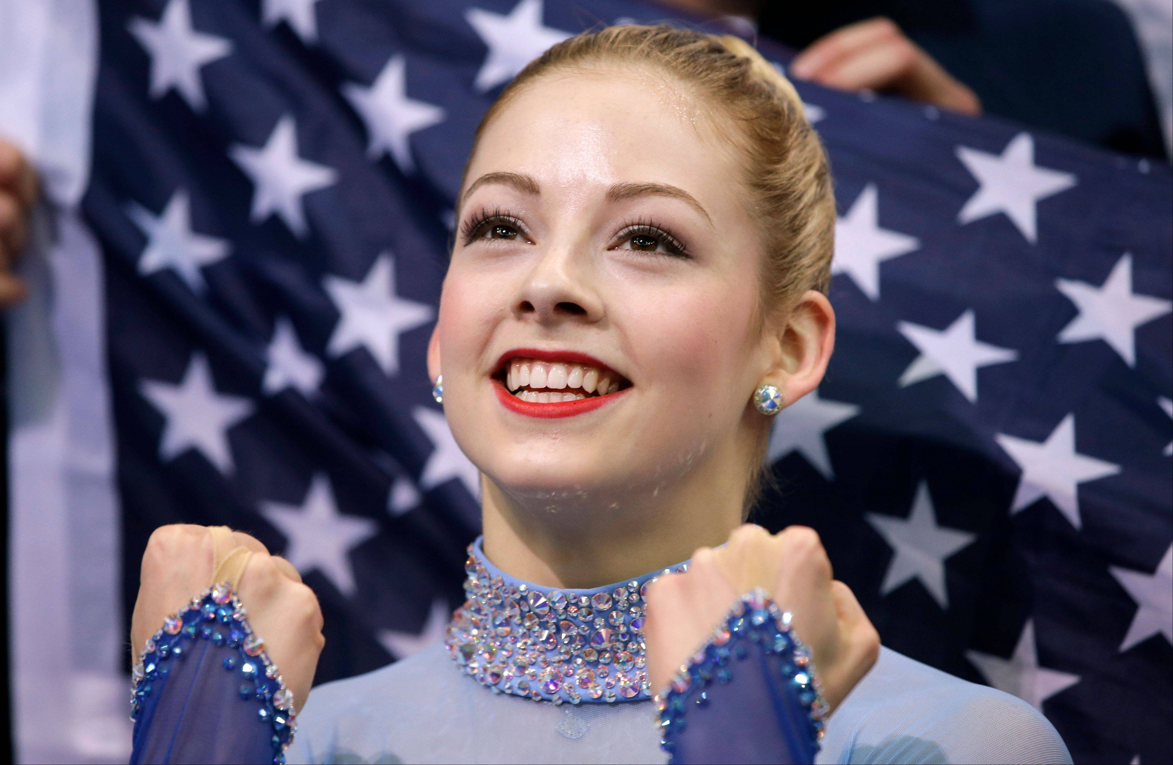 Gracie Gold of the United States reacts in the results area after competing in the women's team free skate figure skating competition at the Iceberg Skating Palace during the 2014 Winter Olympics, Sunday, Feb. 9, 2014, in Sochi, Russia.