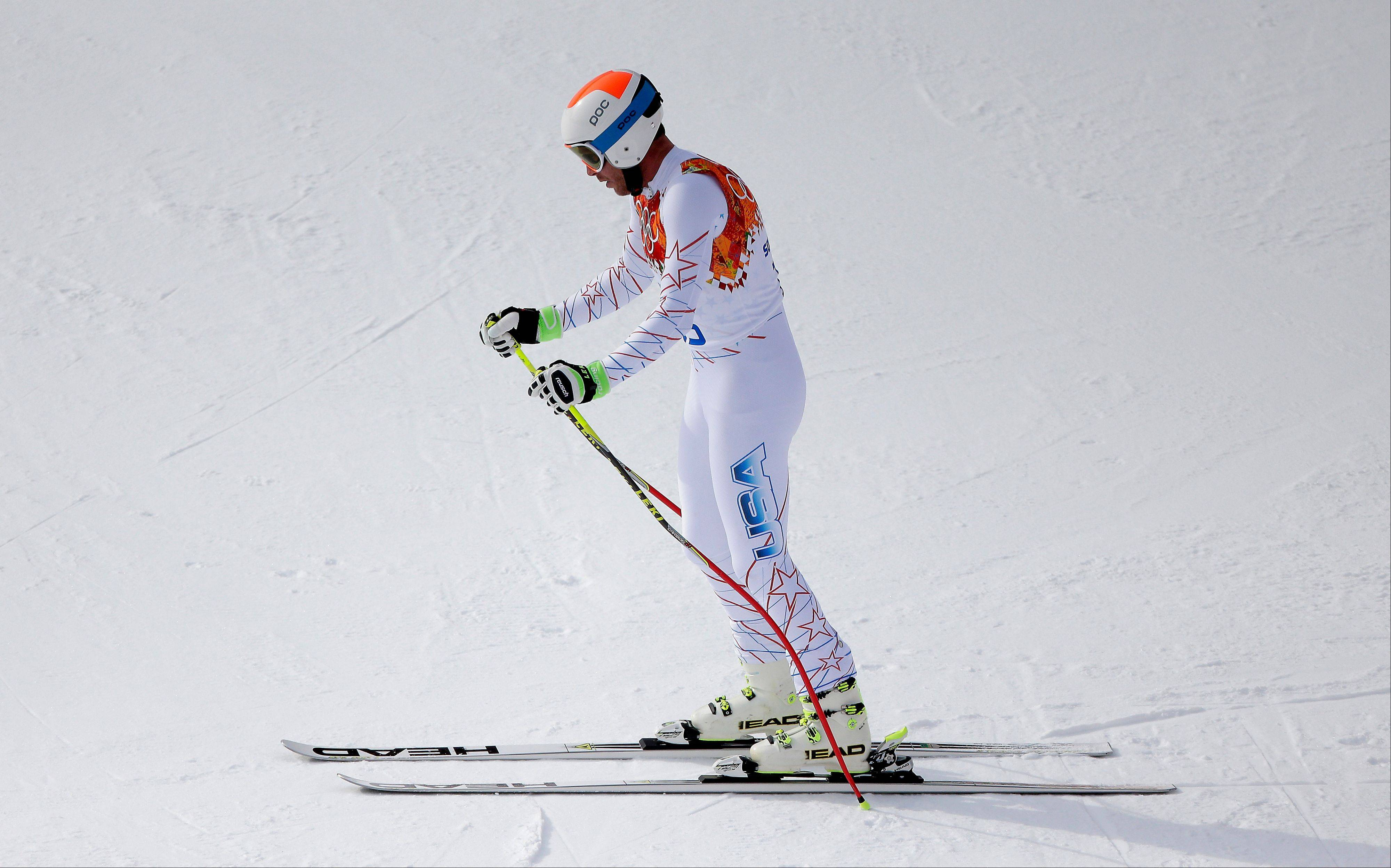 United States' Bode Miller pauses before leaves the course after his run in the men's downhill event at the 2014 Winter Olympics, Sunday, Feb. 9, 2014, in Krasnaya Polyana, Russia.
