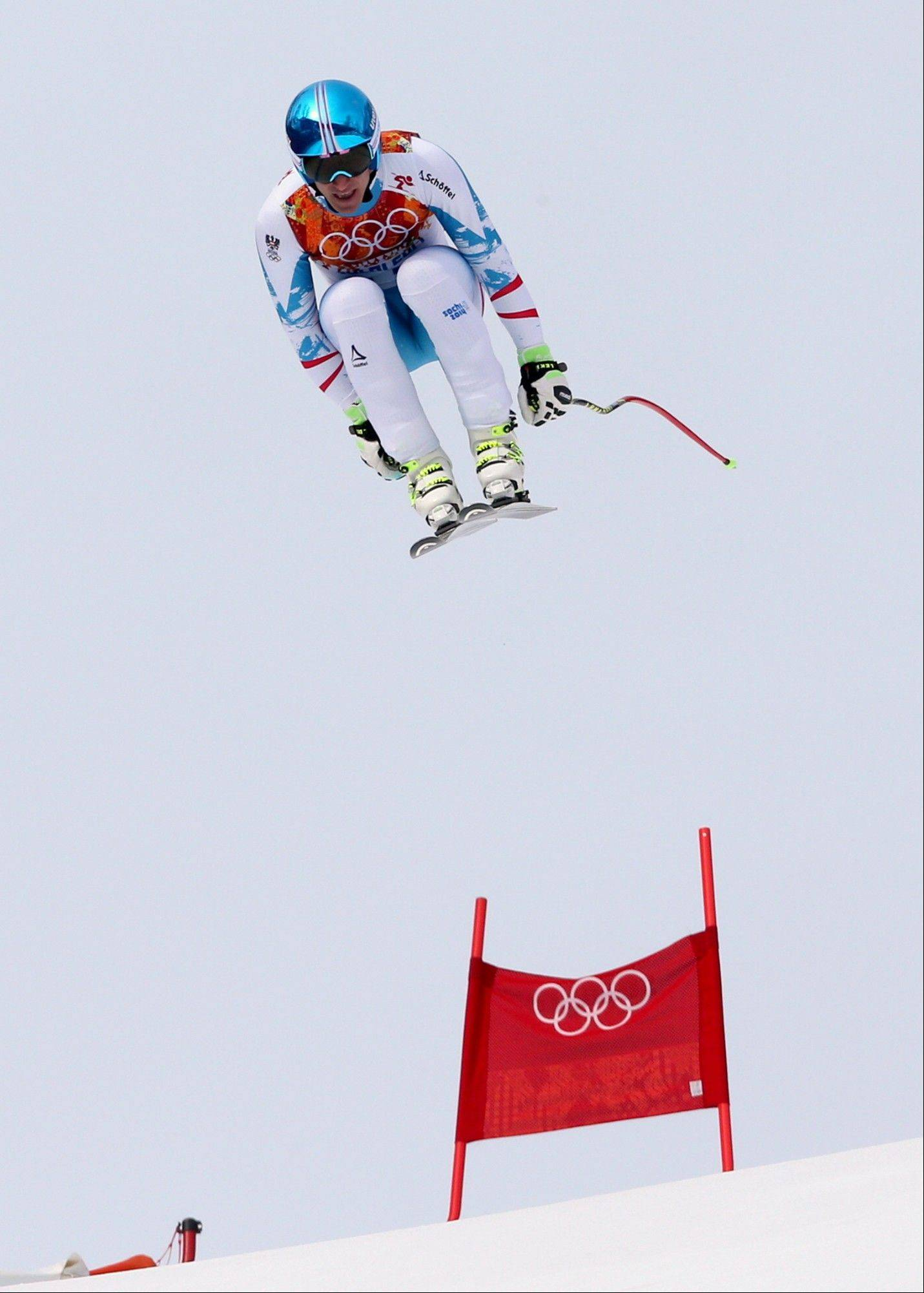 Austria's gold medalist Matthias Mayer jumps during the men's downhill at the Sochi 2014 Winter Olympics, Sunday, Feb. 9, 2014, in Krasnaya Polyana, Russia.