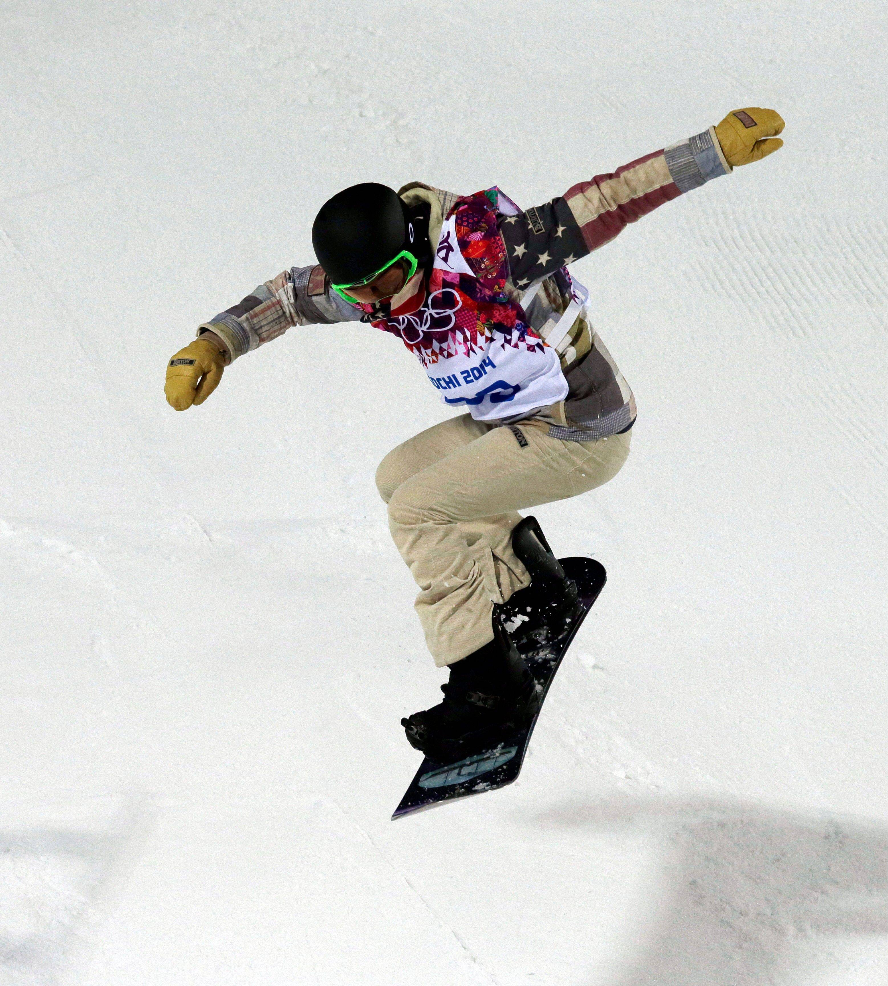 Shaun White of the United States trains in the half pipe at the Rosa Khutor Extreme Park, at the 2014 Winter Olympics, Sunday, Feb. 9, 2014, in Krasnaya Polyana, Russia. Half-pipe competition starts Tuesday Feb. 11.