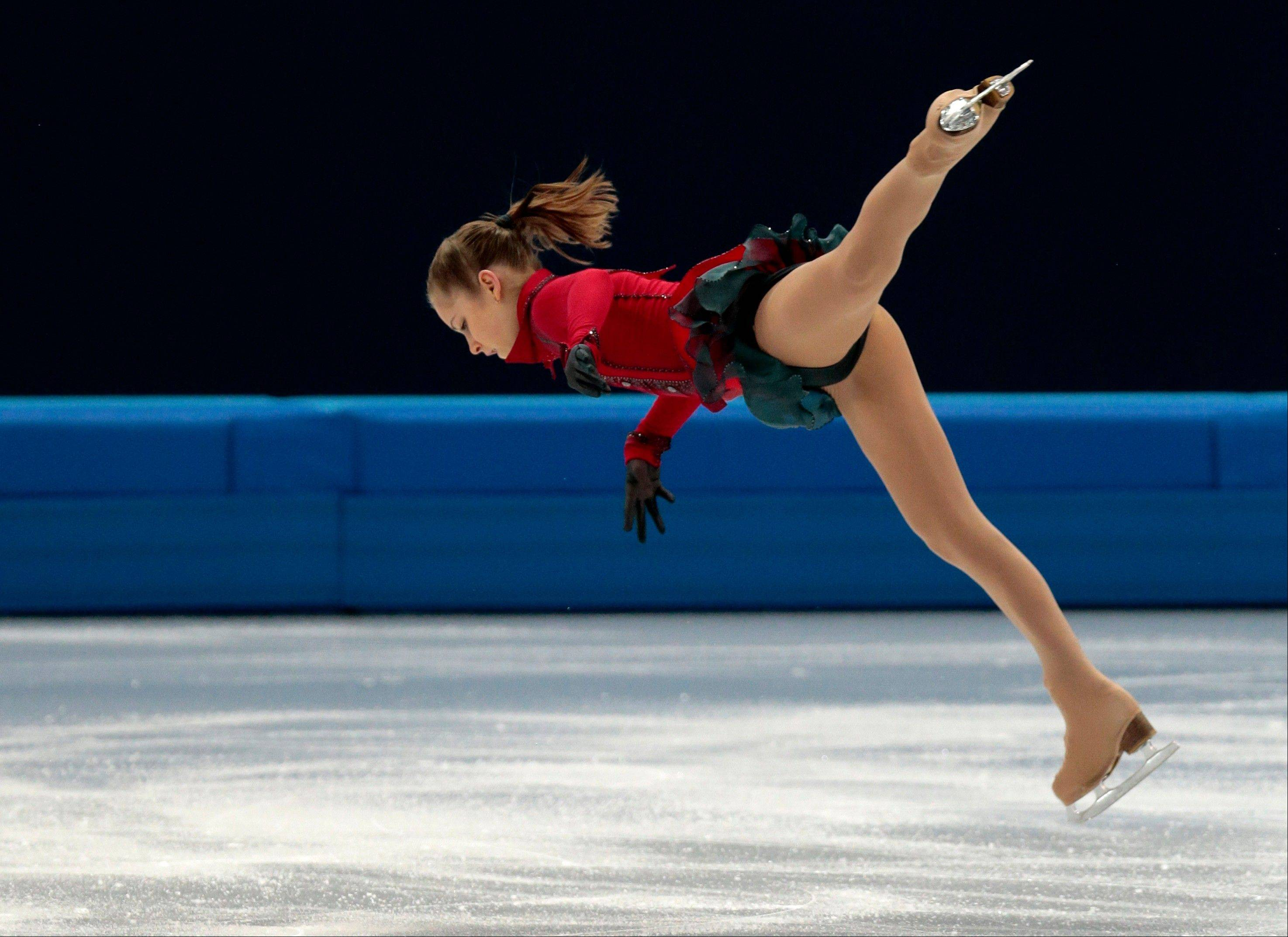 Julia Lipnitskaia of Russia competes in the women's team free skate figure skating competition at the Iceberg Skating Palace during the 2014 Winter Olympics, Sunday, Feb. 9, 2014, in Sochi, Russia.