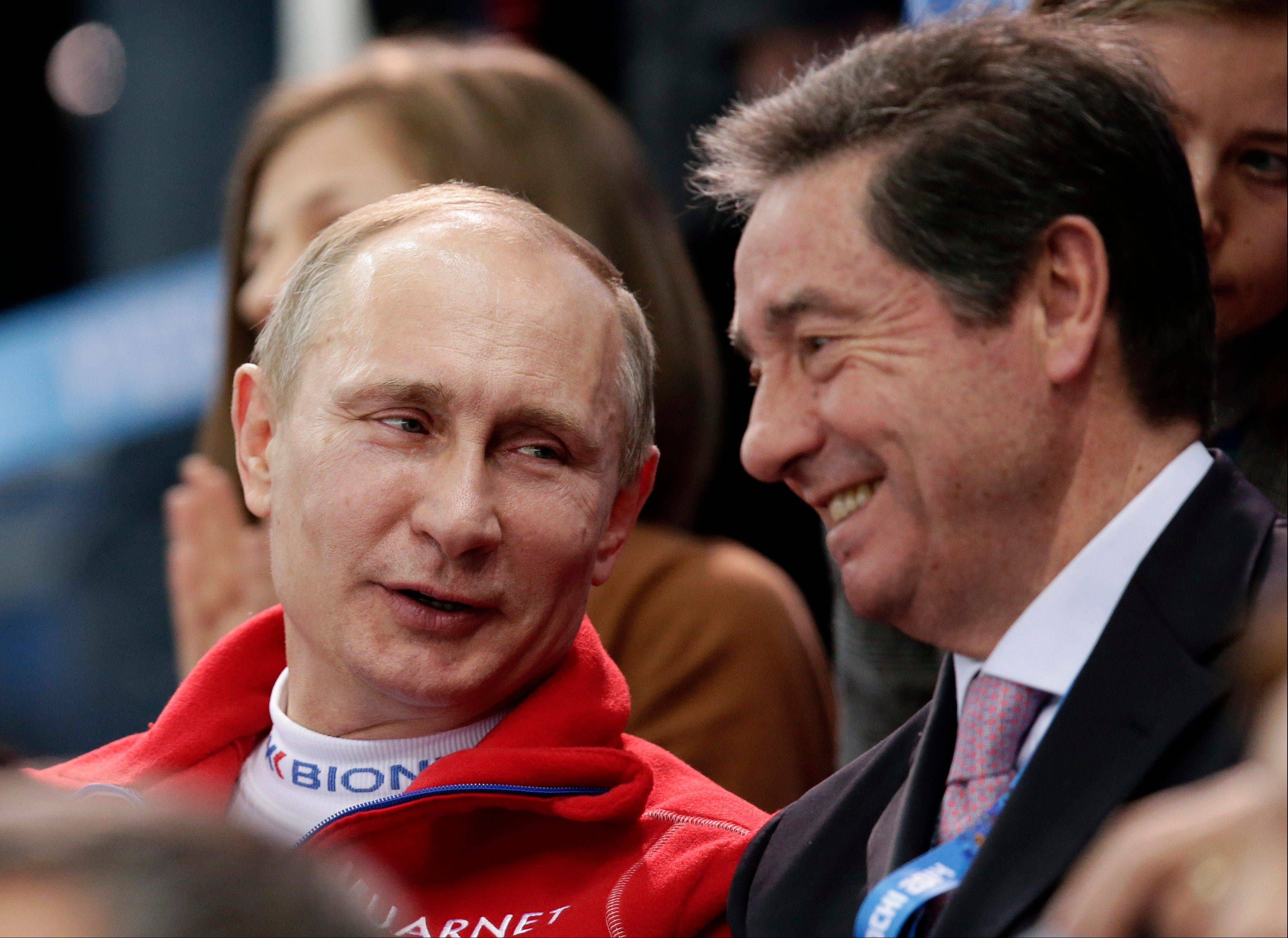 Russian President Vladimir Putin, left, speaks with International Skating Union President Ottavio Cinquanta as he attends the figure skating competition at the Iceberg Skating Palace during the 2014 Winter Olympics, Sunday, Feb. 9, 2014, in Sochi, Russia.