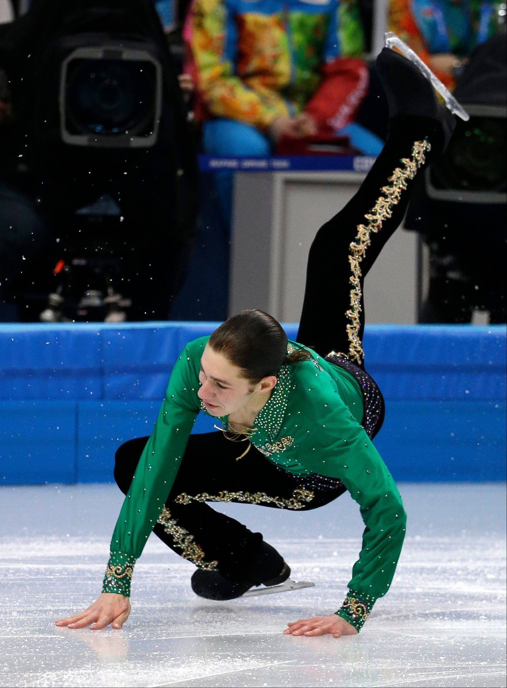 Jason Brown of the United States falls as he competes in the men's team free skate figure skating competition at the Iceberg Skating Palace during the 2014 Winter Olympics, Sunday, Feb. 9, 2014, in Sochi, Russia.