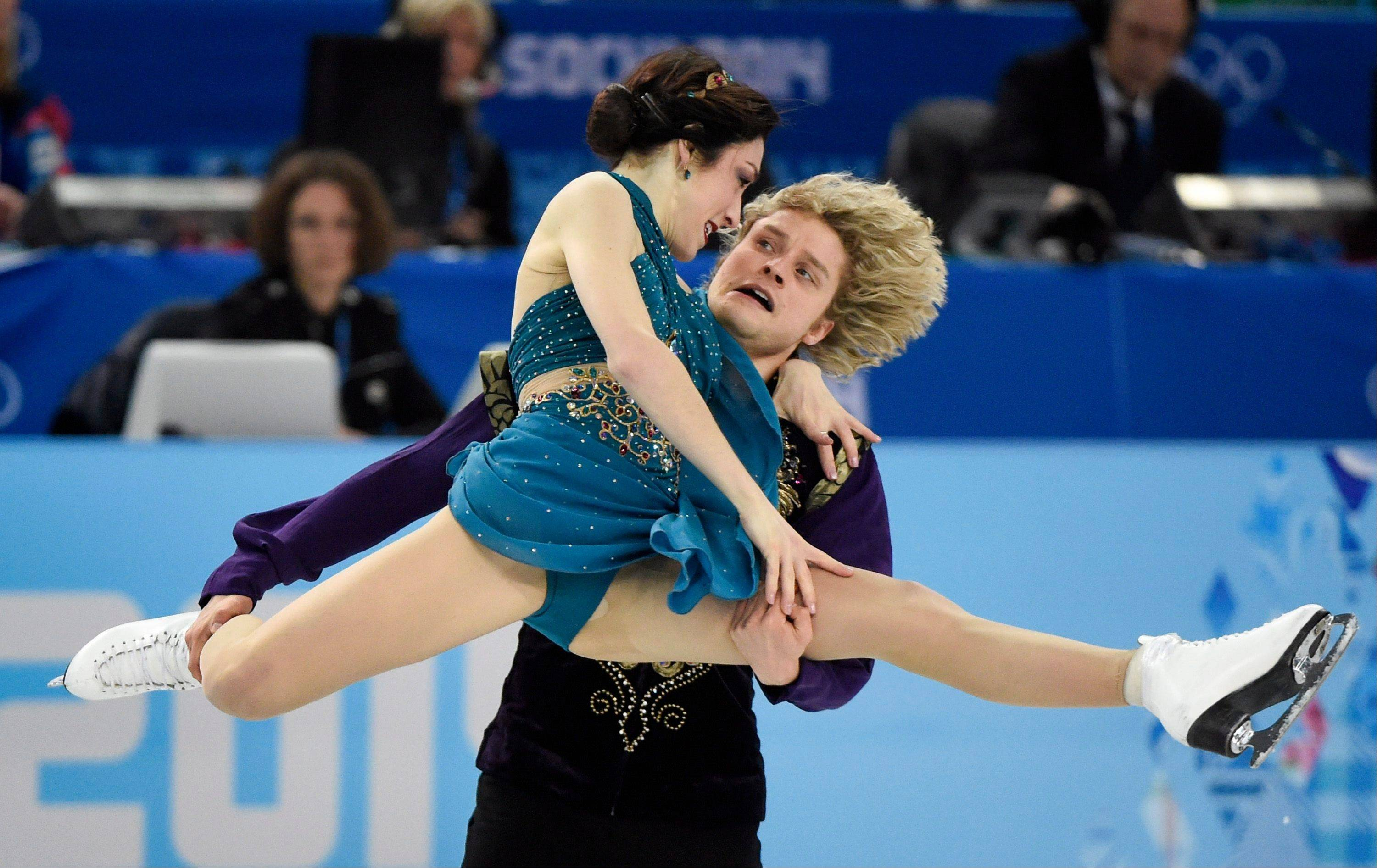 Meryl Davis and Charlie White, of the United States, perform their free dance in the ice dance portion of the team figure skating event at the Winter Olympics, Sunday, Feb. 9, 2014, in Sochi, Russia.
