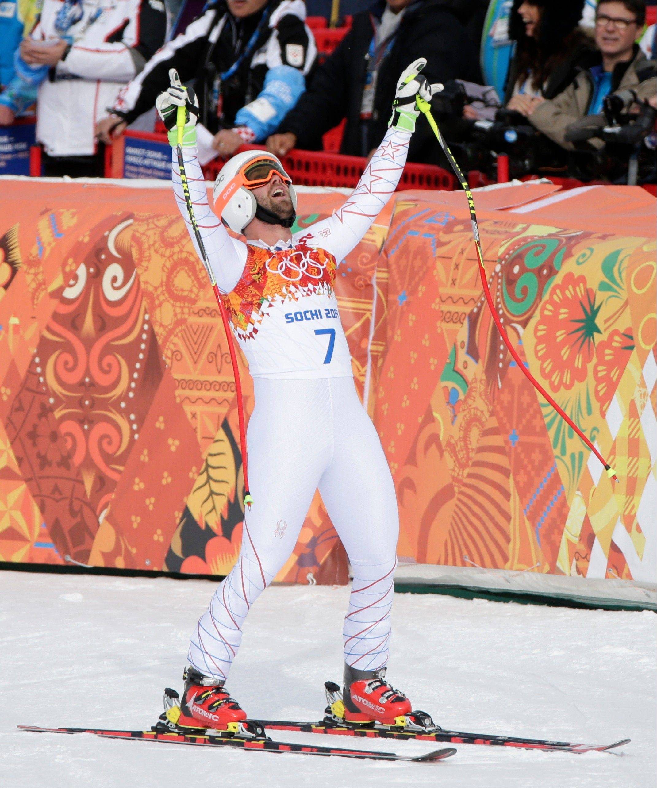 United States' Travis Ganong reacts after finishing the men's downhill at the Sochi 2014 Winter Olympics, Sunday, Feb. 9, 2014, in Krasnaya Polyana, Russia.