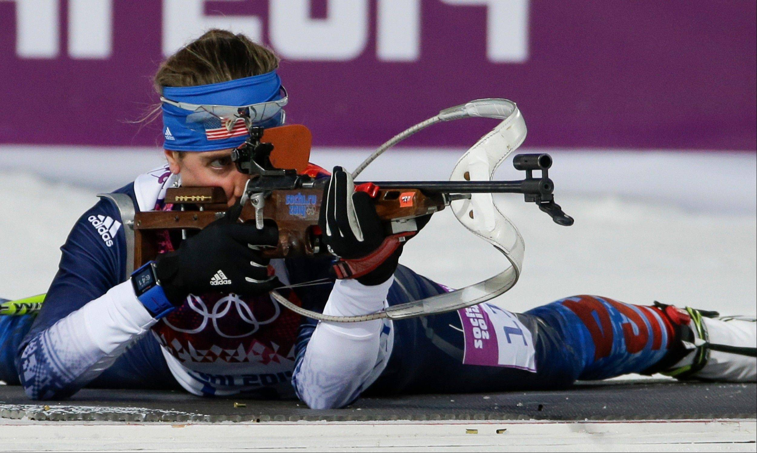 United States' Susan Dunklee shoots during the women's biathlon 7.5k sprint, at the 2014 Winter Olympics, Sunday, Feb. 9, 2014, in Krasnaya Polyana, Russia.