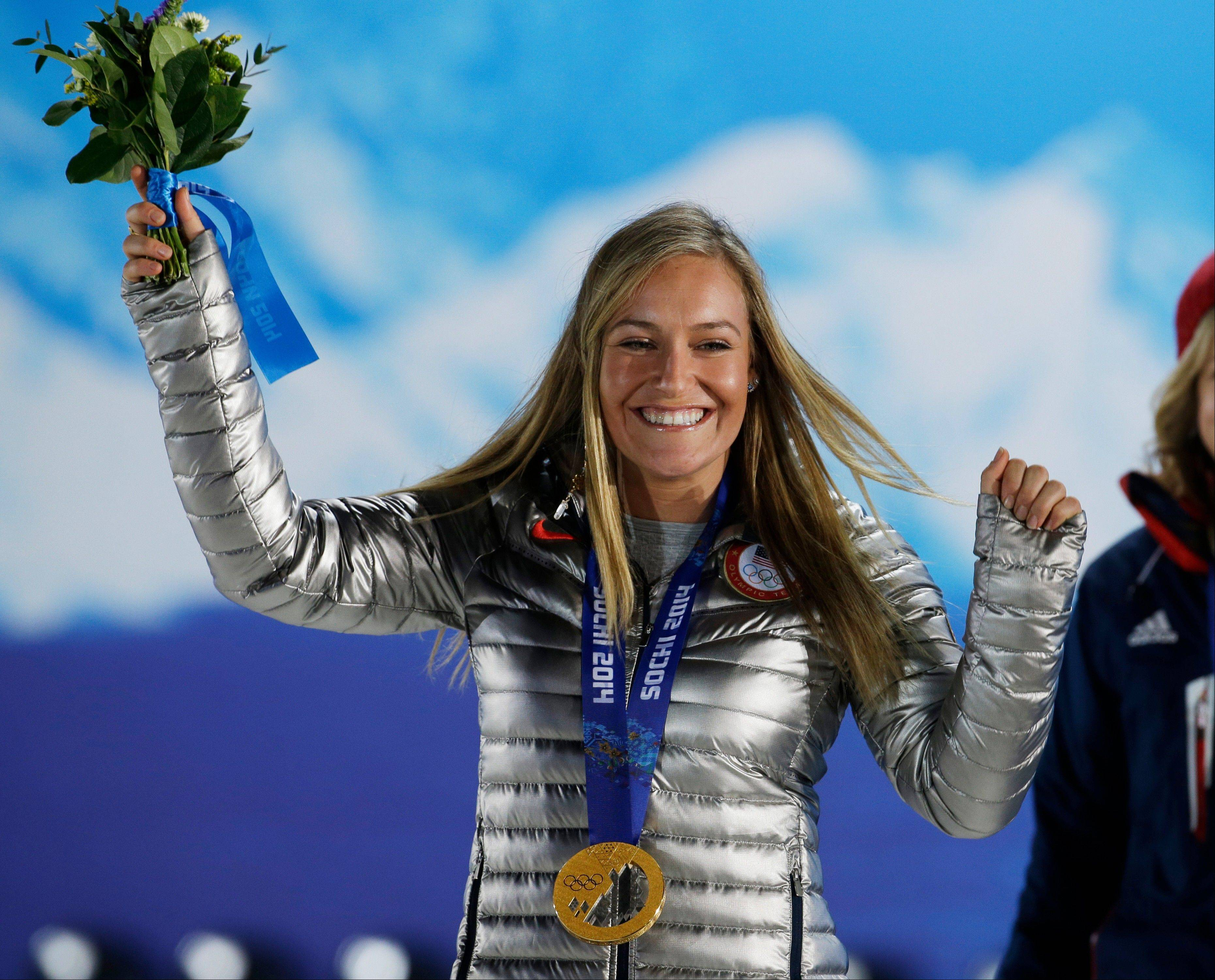 Gold medalist in the women's snowboard slopestyle Jamie Anderson of the United States smiles during the medals ceremony at the 2014 Winter Olympics, Sunday, Feb. 9, 2014, in Sochi, Russia.