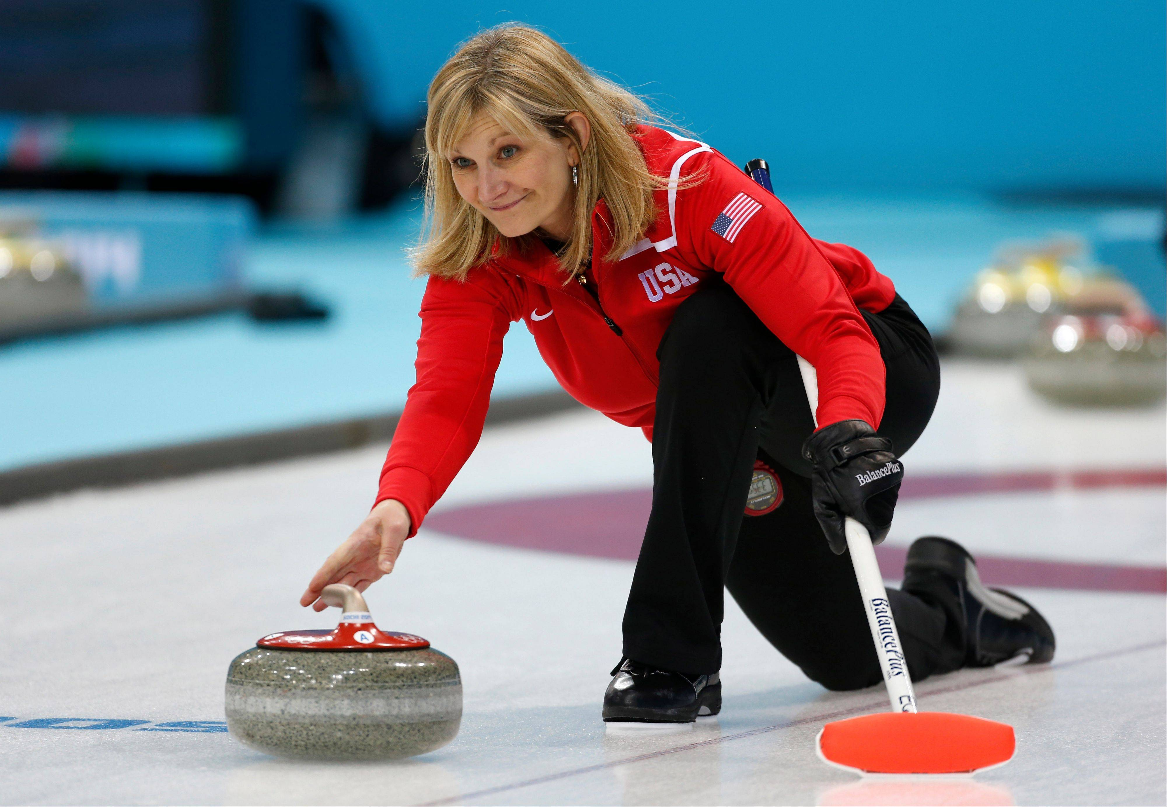 Erika Brown, skip of Team USA, delivers the stone during a women's curling training session at the 2014 Winter Olympics, Sunday, Feb. 9, 2014, in Sochi, Russia.