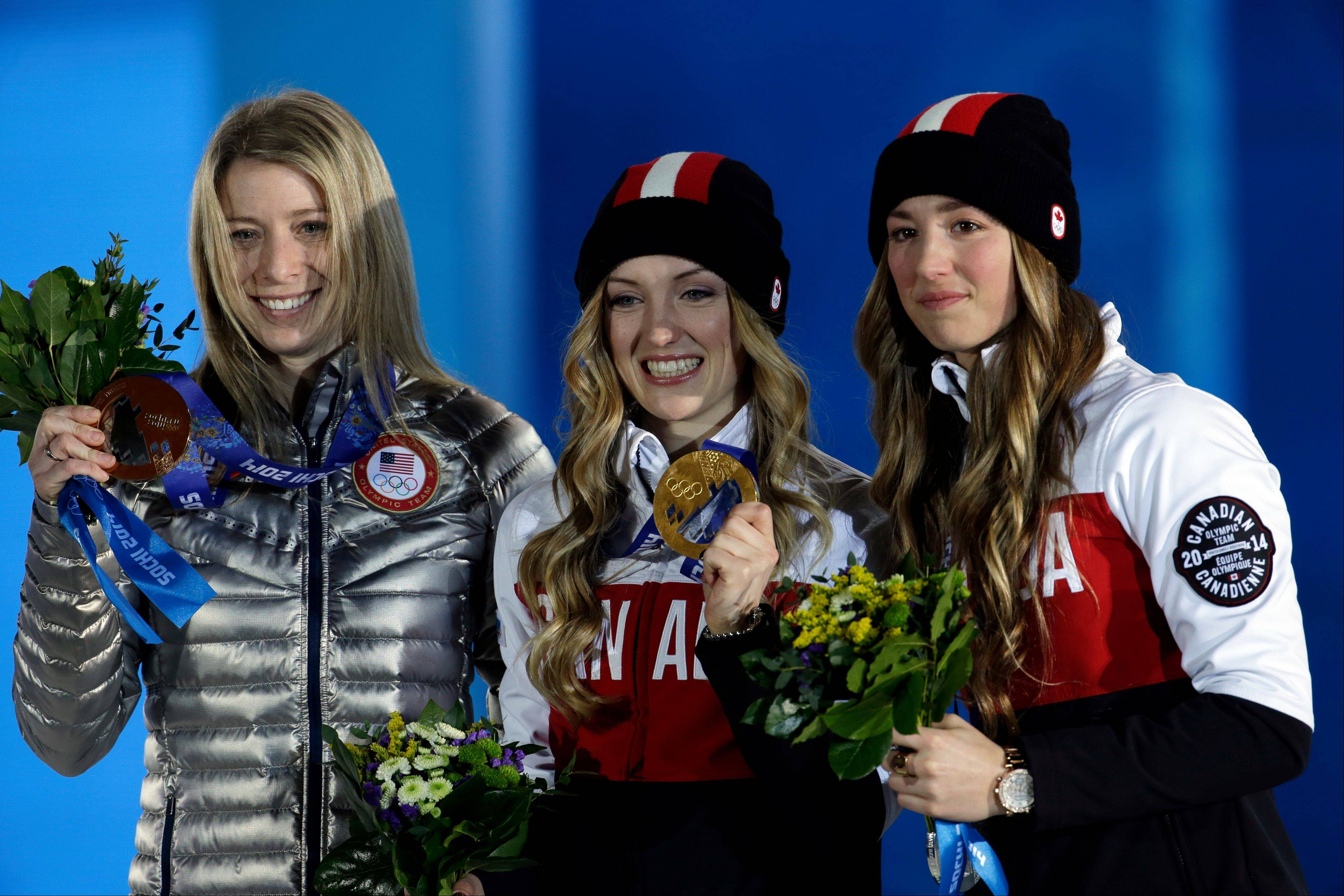 Women's moguls medalists from left, Hannah Kearney of the United States, bronze, Canada's Justine Dufour-Lapointe, gold, and her sister silver medalist Chloe Dufour-Lapointe pose during their medal ceremony at the 2014 Winter Olympics, Sunday, Feb. 9, 2014, in Sochi, Russia.