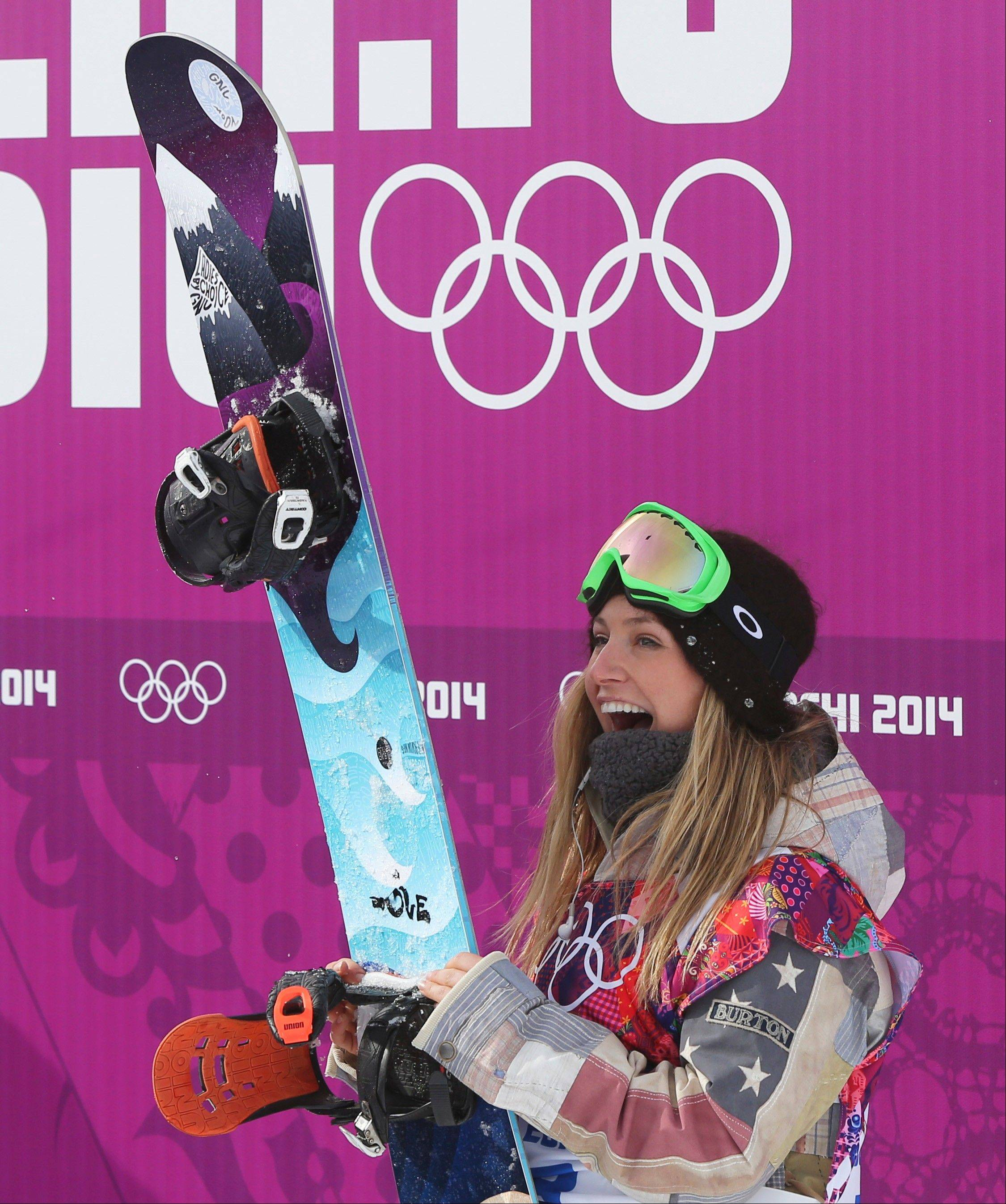 Jamie Anderson of the United States celebrates after winning the women's snowboard slopestyle final at the 2014 Winter Olympics, Sunday, Feb. 9, 2014, in Krasnaya Polyana, Russia.