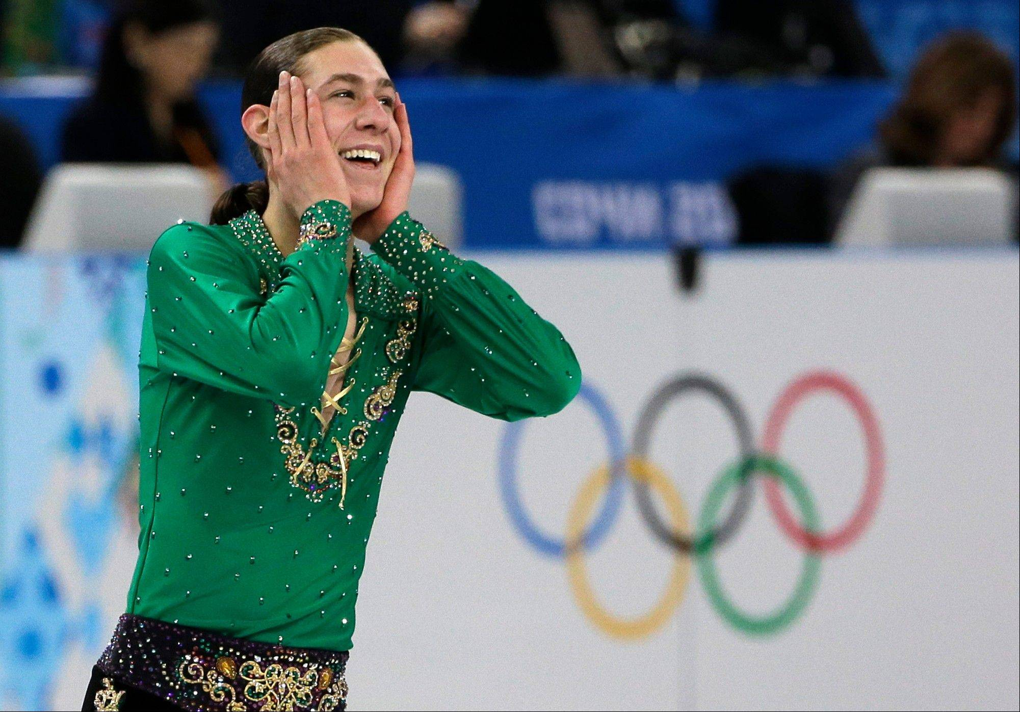 Jason Brown of the United States smiles after competing in the men's team free skate figure skating competition at the Iceberg Skating Palace during the 2014 Winter Olympics, Sunday, Feb. 9, 2014, in Sochi, Russia.