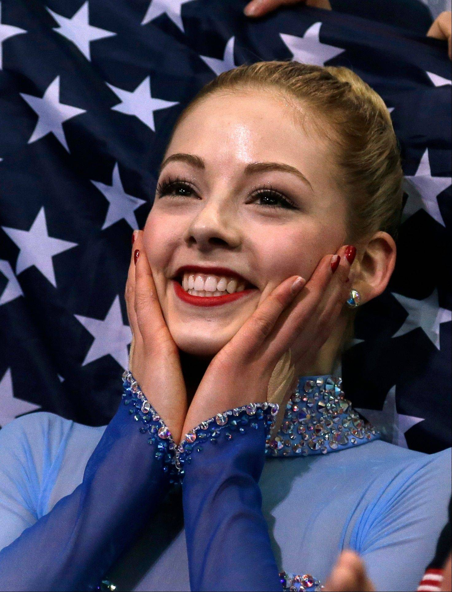 Gracie Gold of the United States sits in the results area after competing in the women's team free skate figure skating competition at the Iceberg Skating Palace during the 2014 Winter Olympics, Sunday, Feb. 9, 2014, in Sochi, Russia.