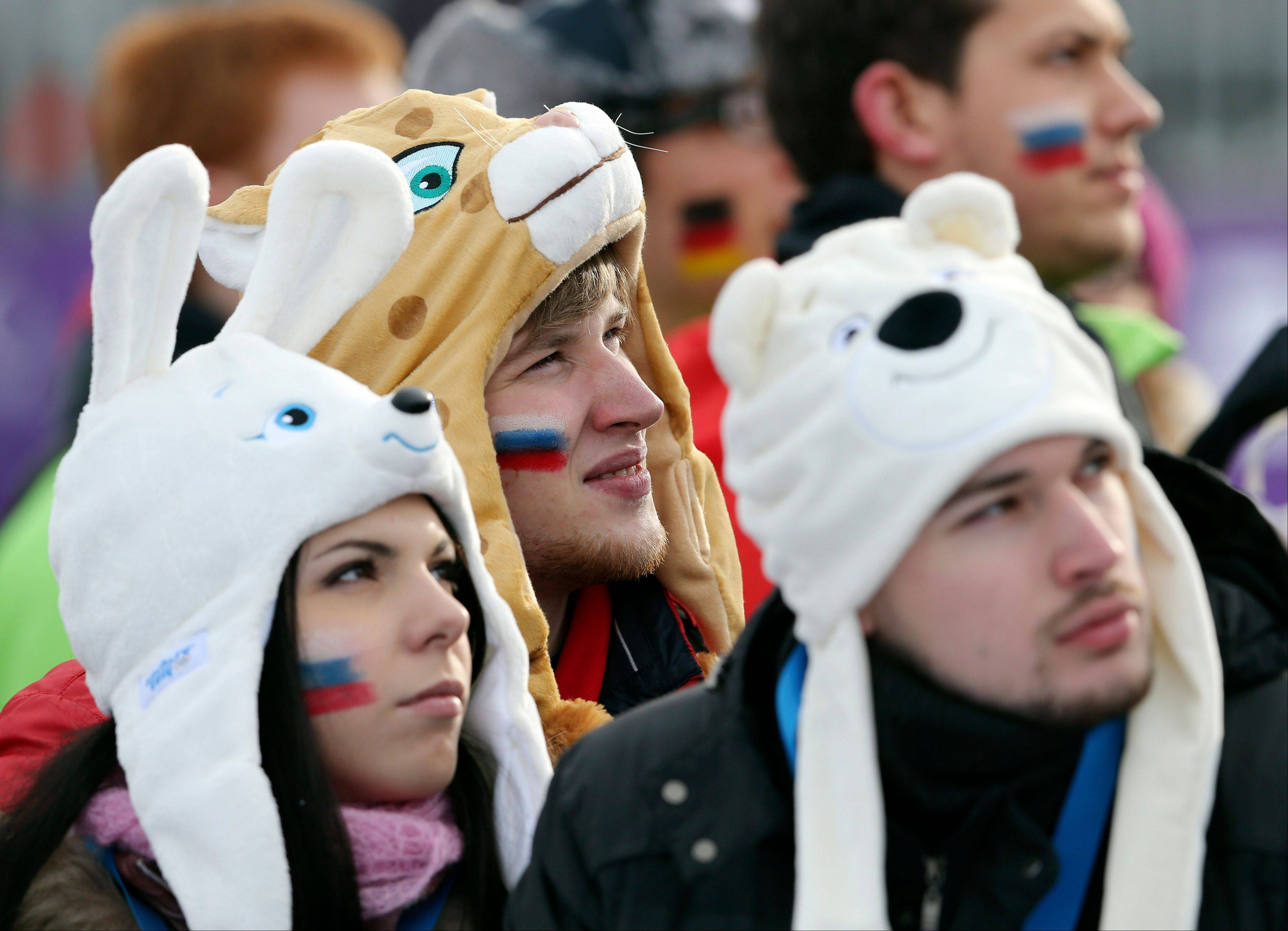 Russian fans wear animal-themed hats during the women's snowboard slopestyle semifinal at the 2014 Winter Olympics, Sunday, Feb. 9, 2014, in Krasnaya Polyana, Russia.