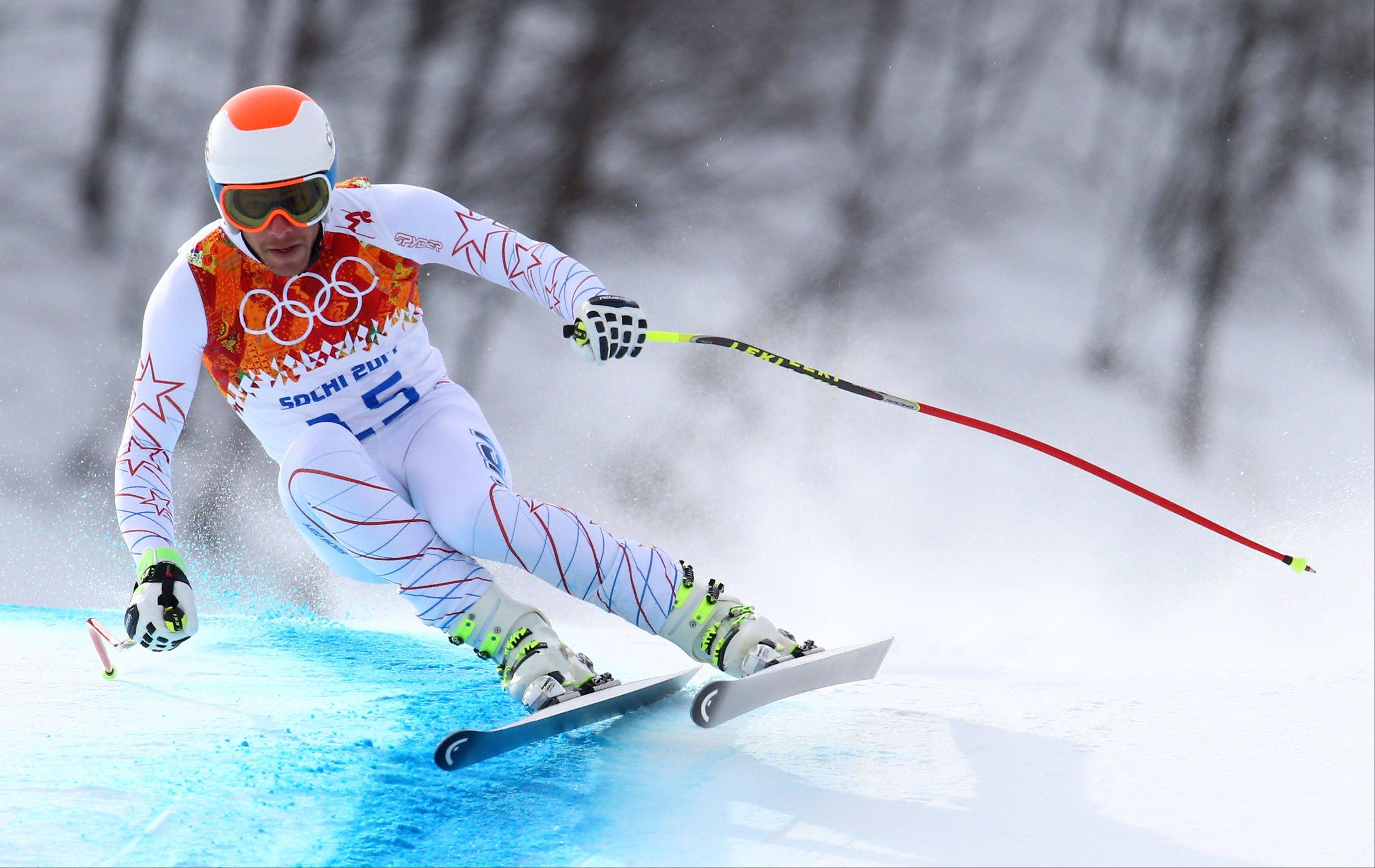 United States' Bode Miller makes a turn during the men's downhill at the Sochi 2014 Winter Olympics, Sunday, Feb. 9, 2014, in Krasnaya Polyana, Russia.