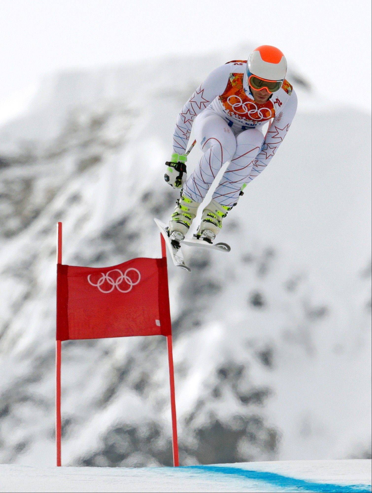 United States' Bode Miller jumps during the men's downhill at the Sochi 2014 Winter Olympics, Sunday, Feb. 9, 2014, in Krasnaya Polyana, Russia.