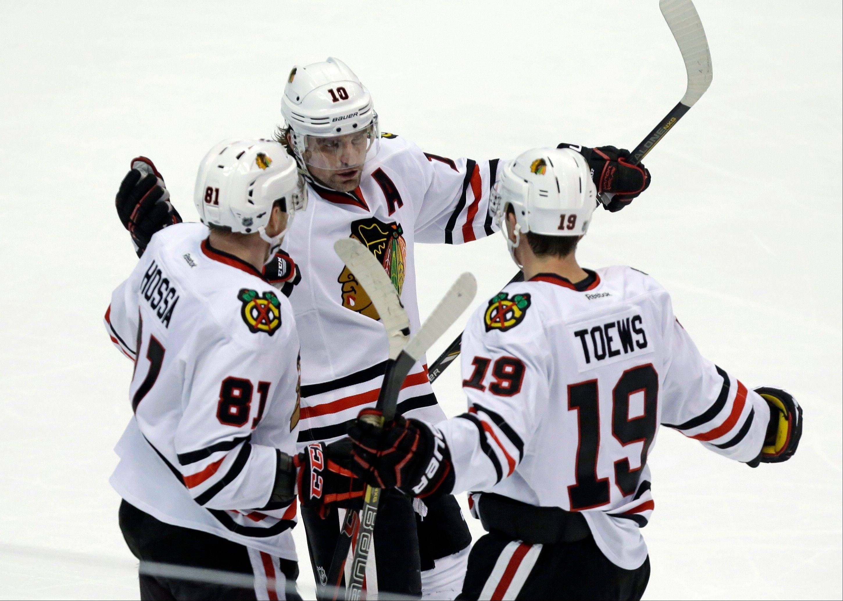 Patrick Sharp (10) and right winger Marian Hossa (81) celebrate a goal by center Jonathan Toews (19) against the Anaheim Ducks in the third period on Wednesday, Feb. 5, 2014. The Blackhawks have 84 points through 60 games, better than all defending champs to this point in the season since 2007 except the 2009 Red Wings.