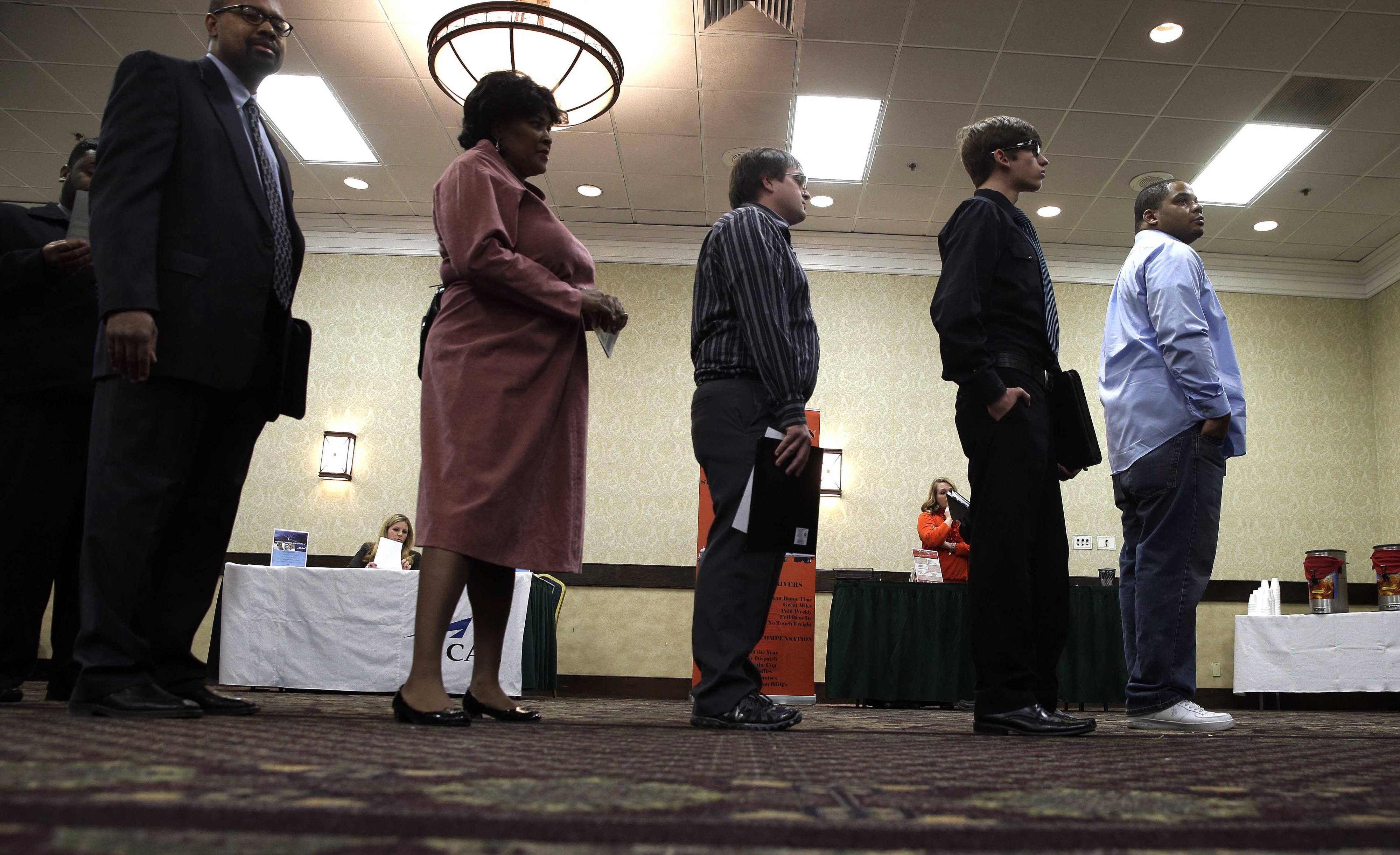 Job seekers line up to meet a prospective employer at a career fair at a hotel in Dallas. Two straight weak job reports have raised doubts about economists' predictions of breakout growth in 2014.