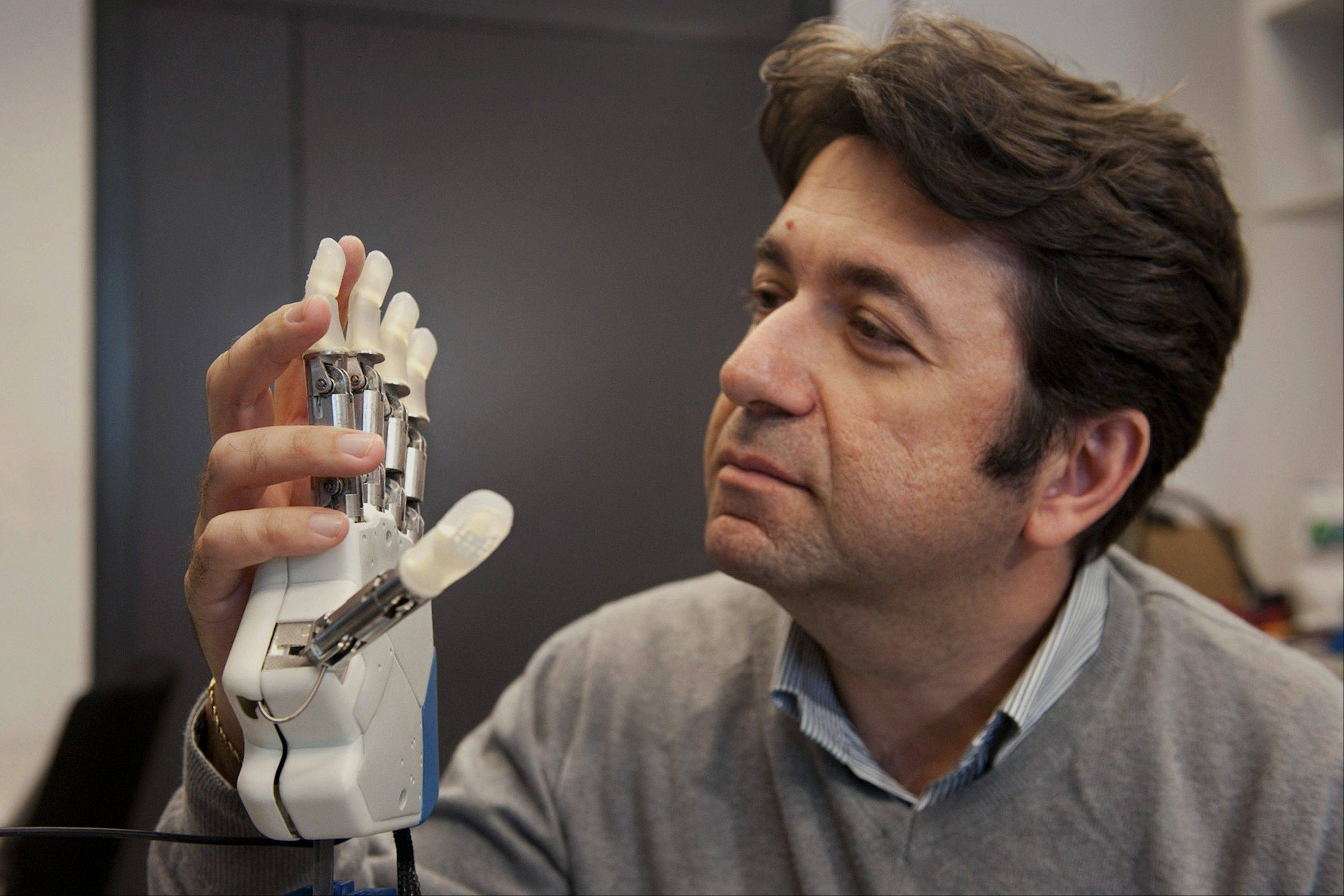 To feel what you touch, that's the holy grail for artificial limbs. In a step toward that goal, European researchers created a robotic hand that let an amputee feel differences between a bottle, a baseball and a mandarin orange.