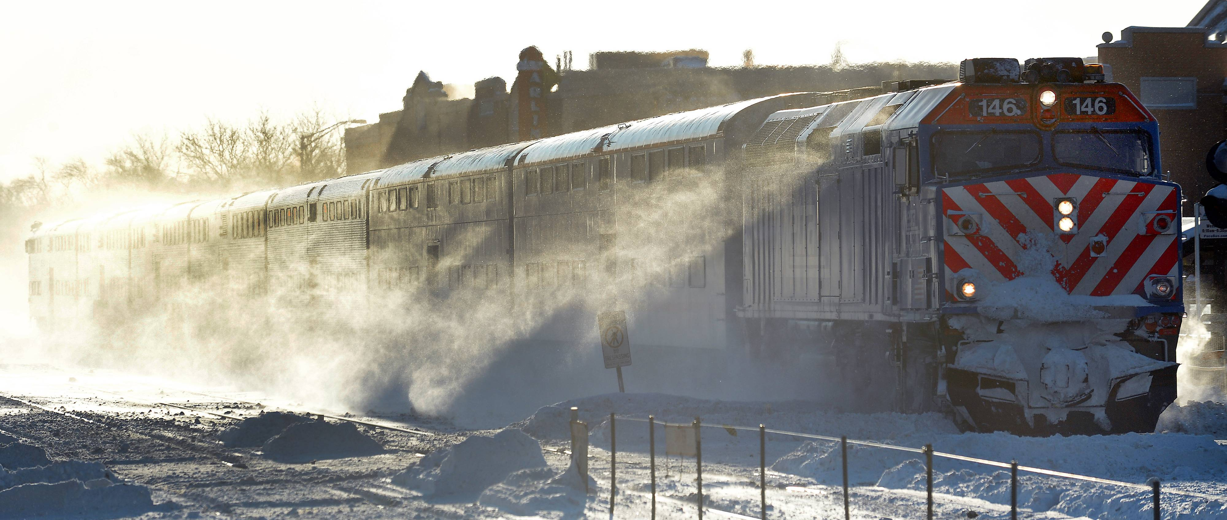 A Metra train plows past the Arlington Heights station in subzero temperatures last month.