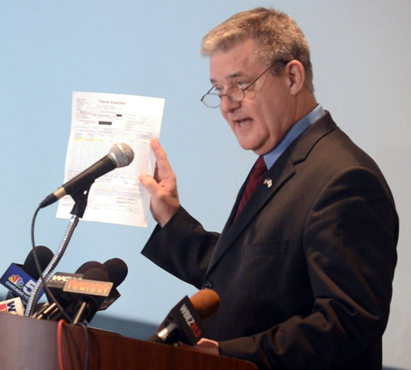 Illinois State Treasurer Dan Rutherford speaks during a news conference in Schaumburg about sexual harassment accusations that have been made against him. He distributed documents he said refute the claims.