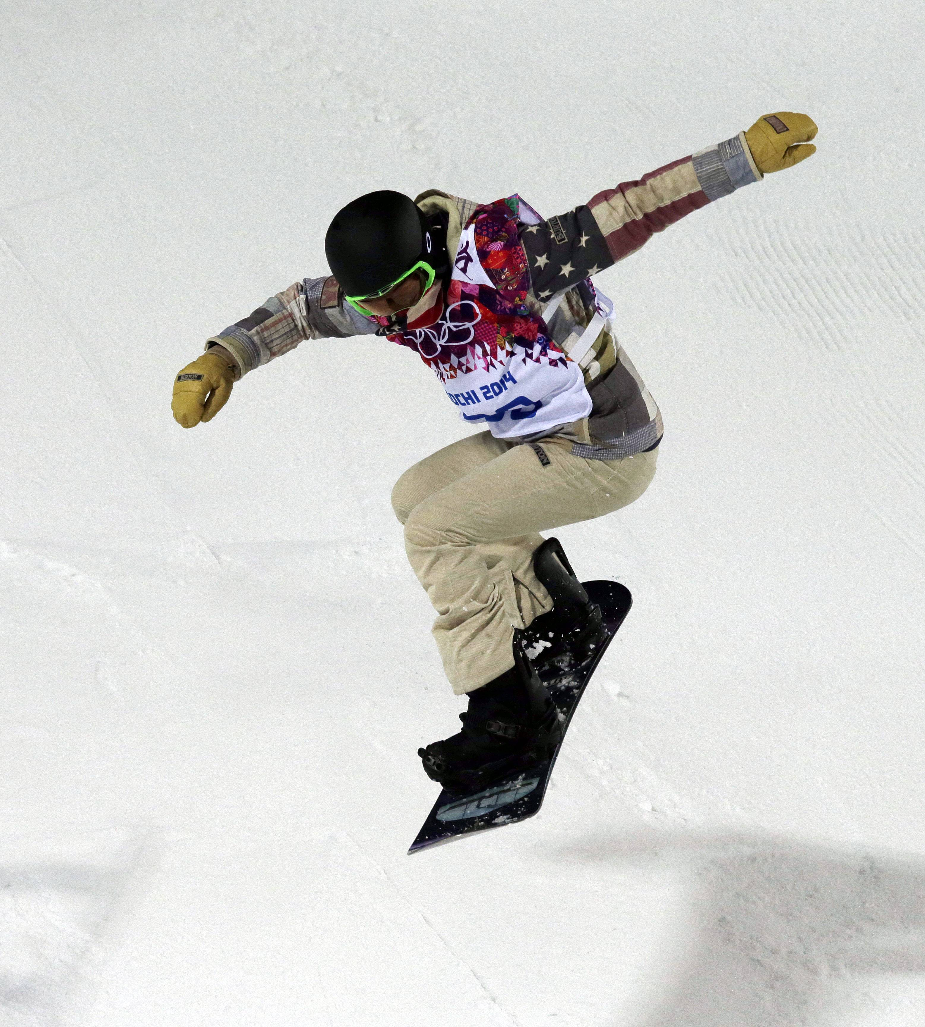 Shaun White of the United States trains in the half pipe at the Rosa Khutor Extreme Park, at the 2014 Winter Olympics Sunday in Krasnaya Polyana, Russia. Half-pipe competition starts Tuesday.