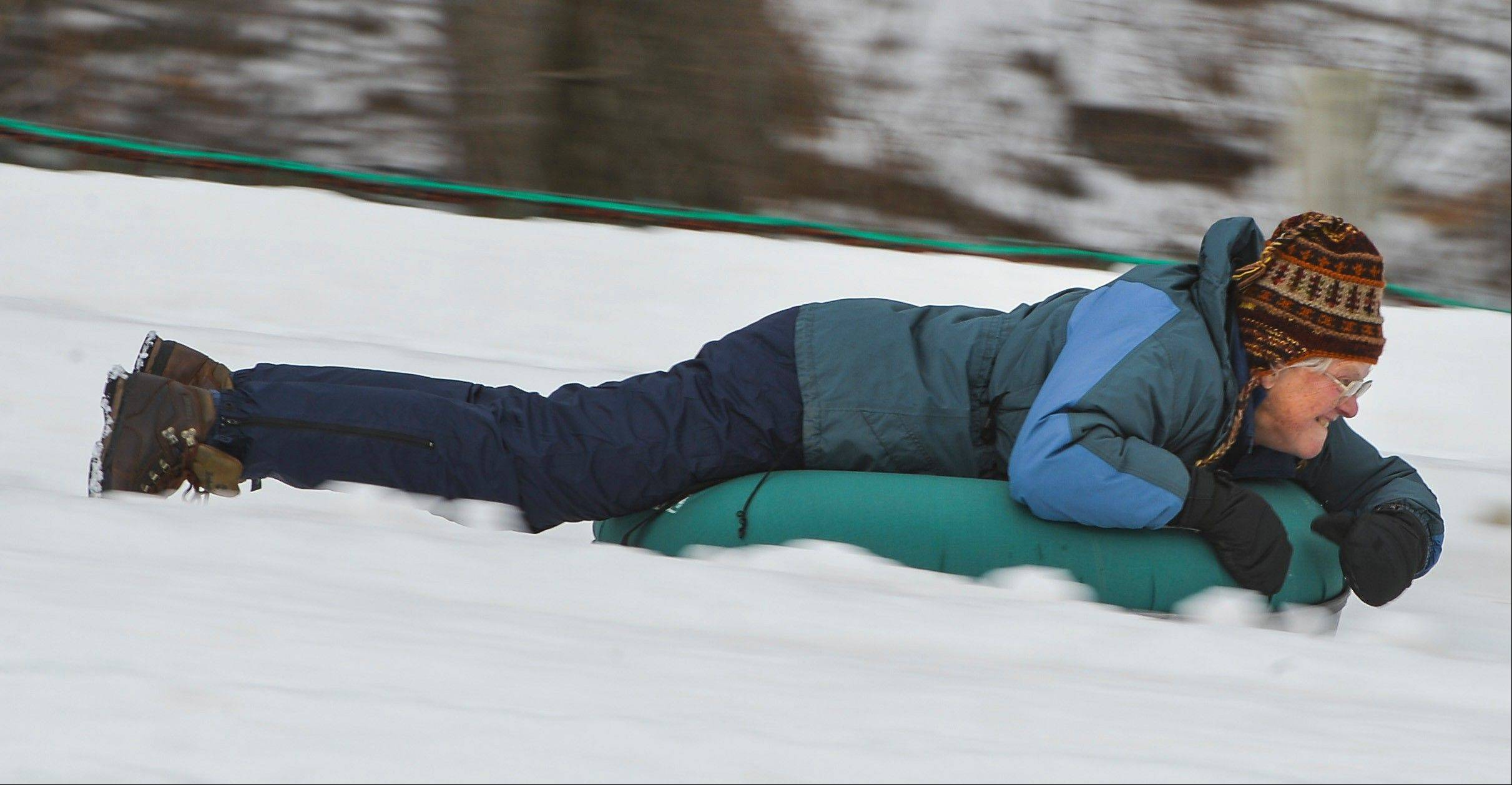Gail Flanagan slides down a hill on a snow tube on Jan. 31, at Whitetail Resort in Mercersburg, Pa. She and her fellow retirees from Gaithersburg, Md. took a day trip to Whitetail.