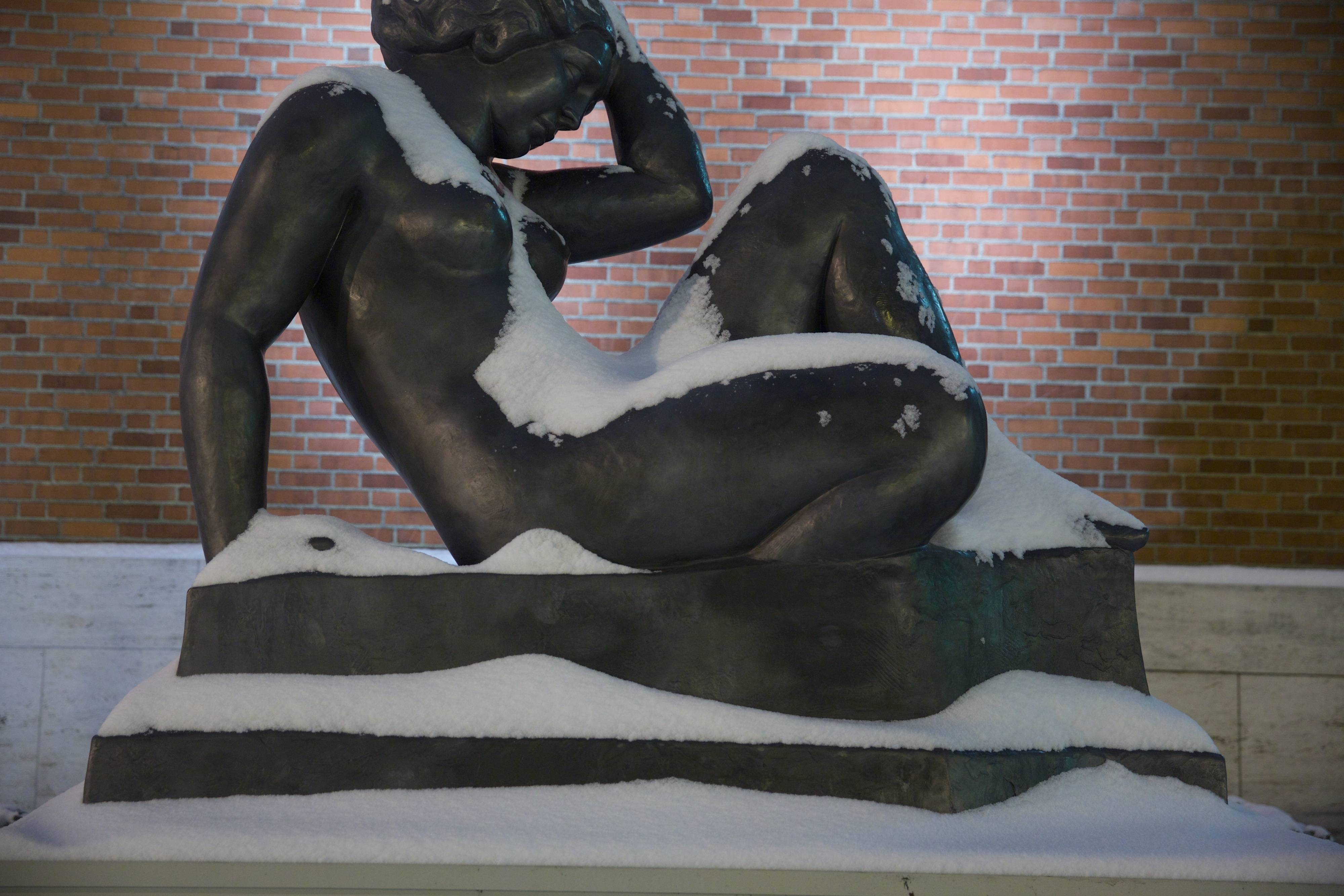 "In this photo taken on Thursday, Feb. 6, 2014, the sculpture ""La Montagne,"" by french artists Aristide Maillol is covered in snow at the Portland Art Museum in Portland, Ore."