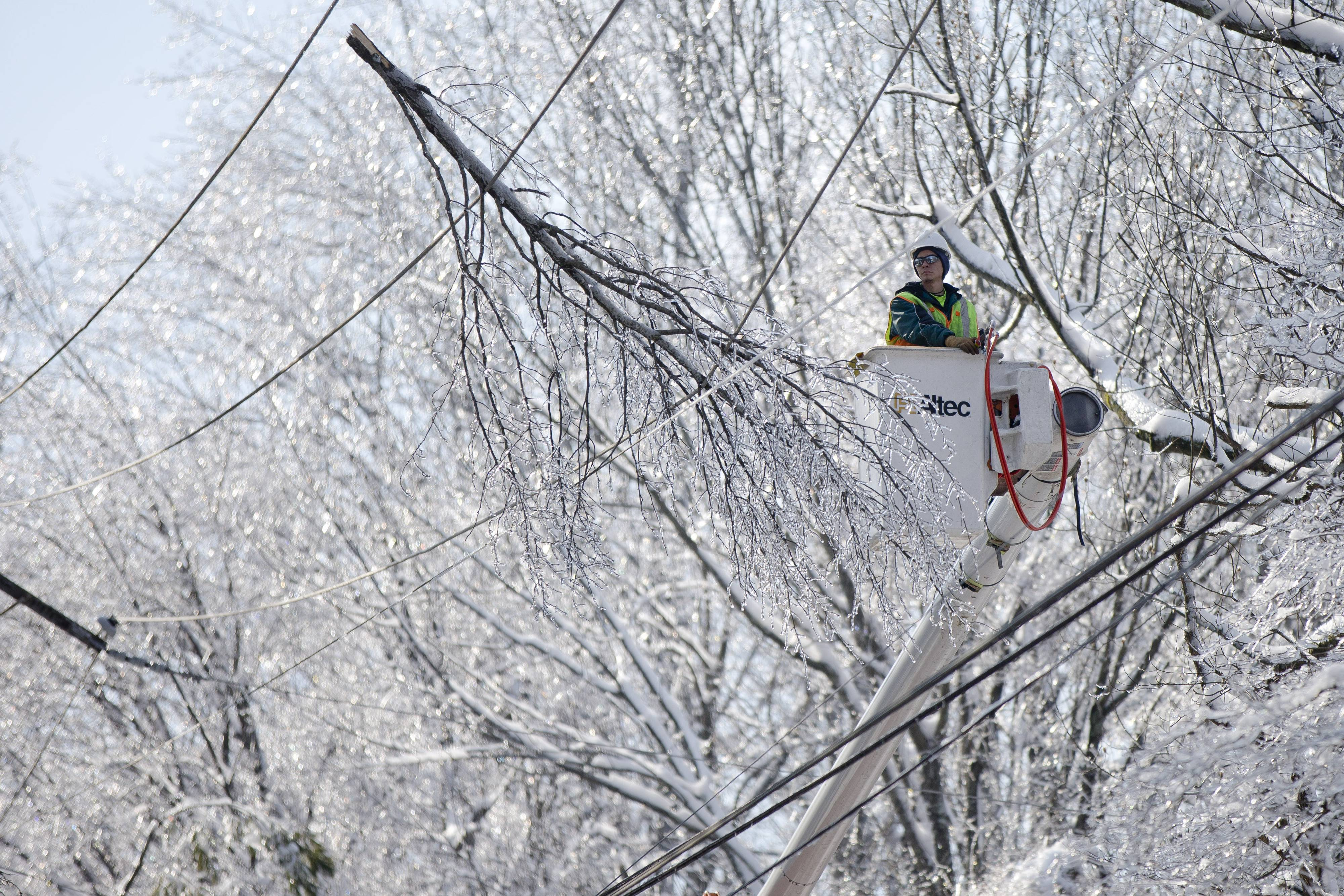 A linesman works to restore electrical power, Friday, Feb. 7, 2014, in Downingtown, Pa. A small army of electricity restoration crews labored Friday to reconnect about 330,000 customers in Pennsylvania and Maryland.