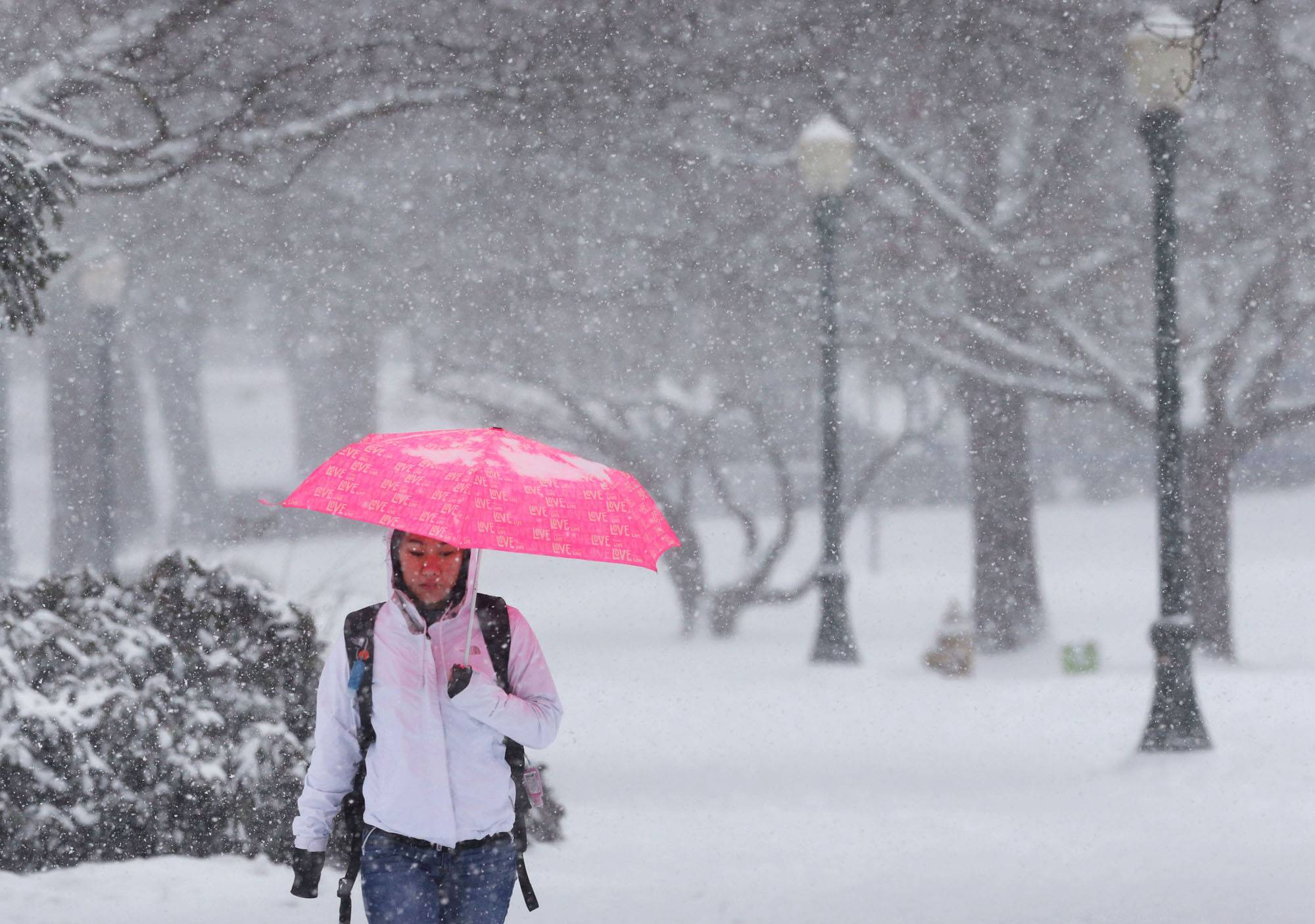 University of Oregon student Nitasha Alvarez makes her way through the UO campus in Eugene as a new round of snow descends on the Willamette Valley Friday, Feb. 7, 2014.