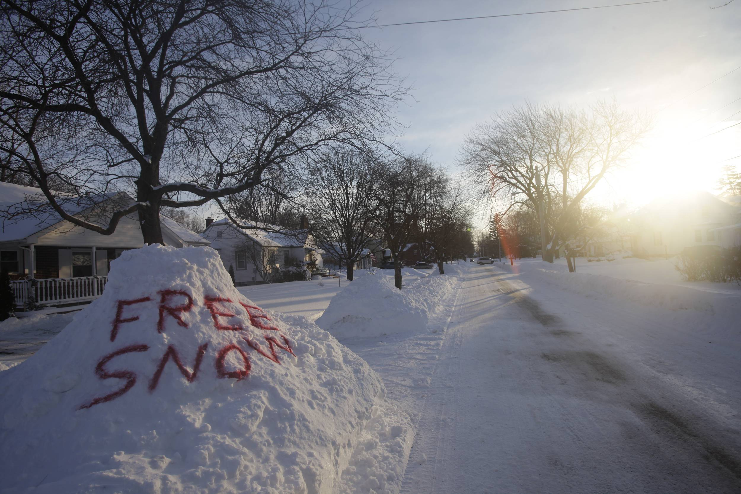 A pile of snow is seen spray painted, Friday, Feb. 7, 2014, along a residential street in Bowling Green, Ohio. Parts of Ohio have seen record amounts of snow this winter.