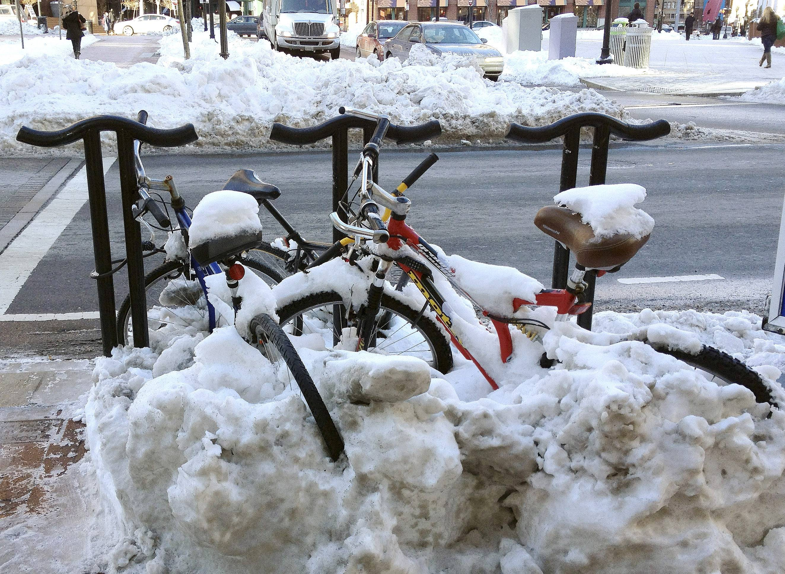 Bicycles remained covered with snow in downtown Boston, Friday, Feb. 7, 2014, after a Wednesday storm dropped more than 10 inches of snow on the city, according to the National Weather Service.