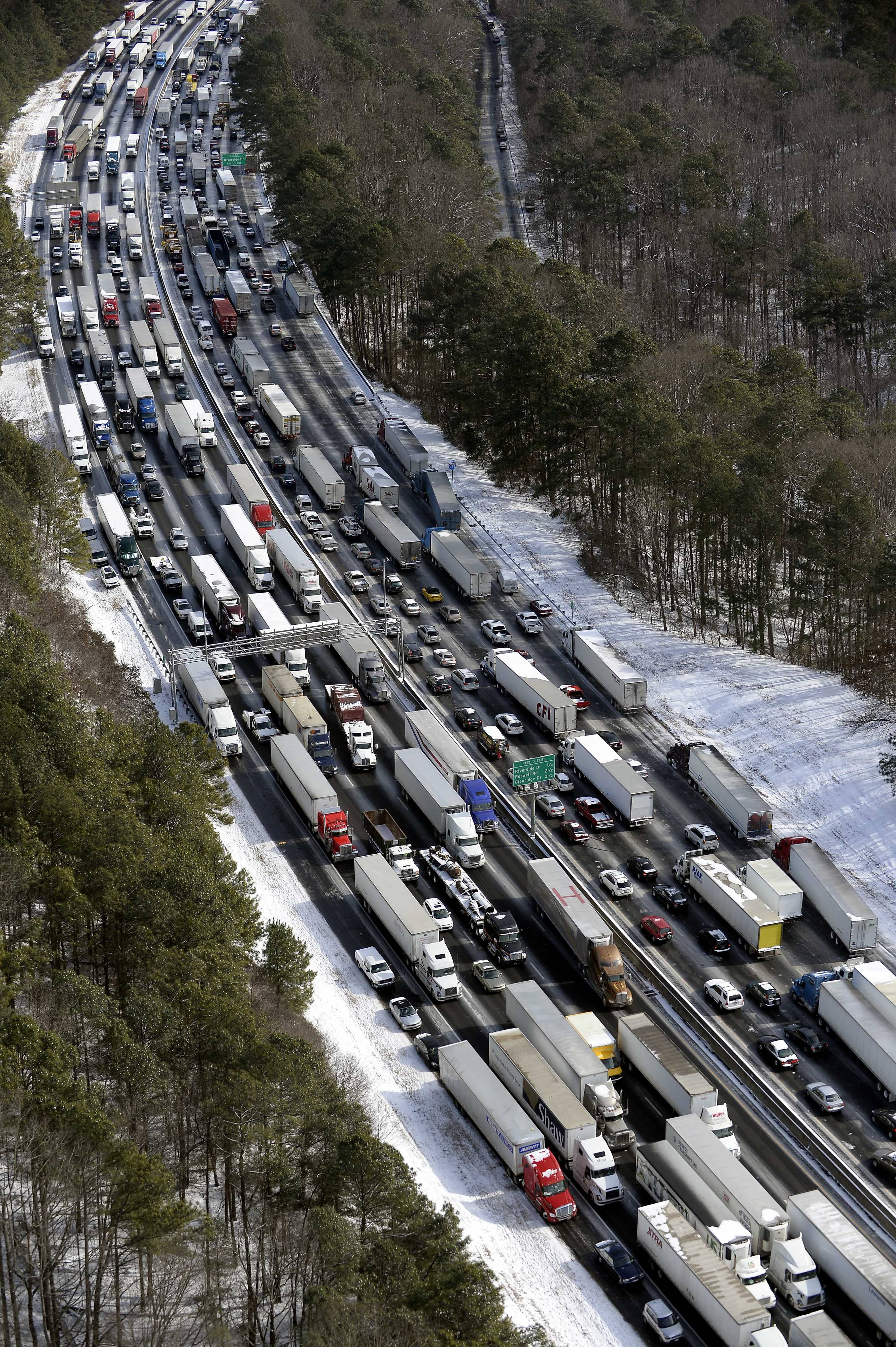 Traffic is snarled along the Interstate 285 perimeter, north of the metro area after a winter snowstorm, in Atlanta. With memories of thousands of vehicles gridlocked for hours on icy metro Atlanta highways fresh in their minds, emergency officials and elected leaders in north Georgia were preparing Monday, Feb. 10, 2014, for another round of winter weather.