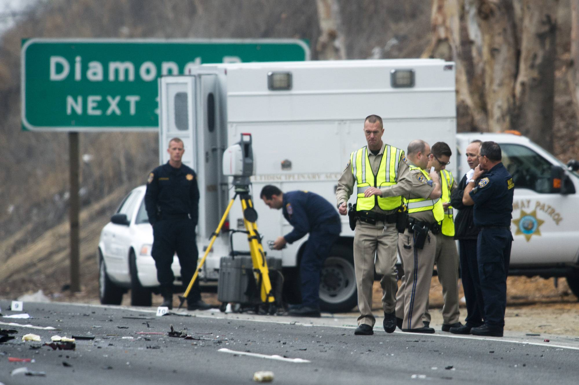 Officials investigate the scene of a multiple vehicle accident where 6 people were killed on the westbound Pomona Freeway in Diamond Bar, Calif. on Sunday morning, Feb. 9, 2013. Authorities say a wrong-way driver caused the pre-dawn crash that left six people dead.