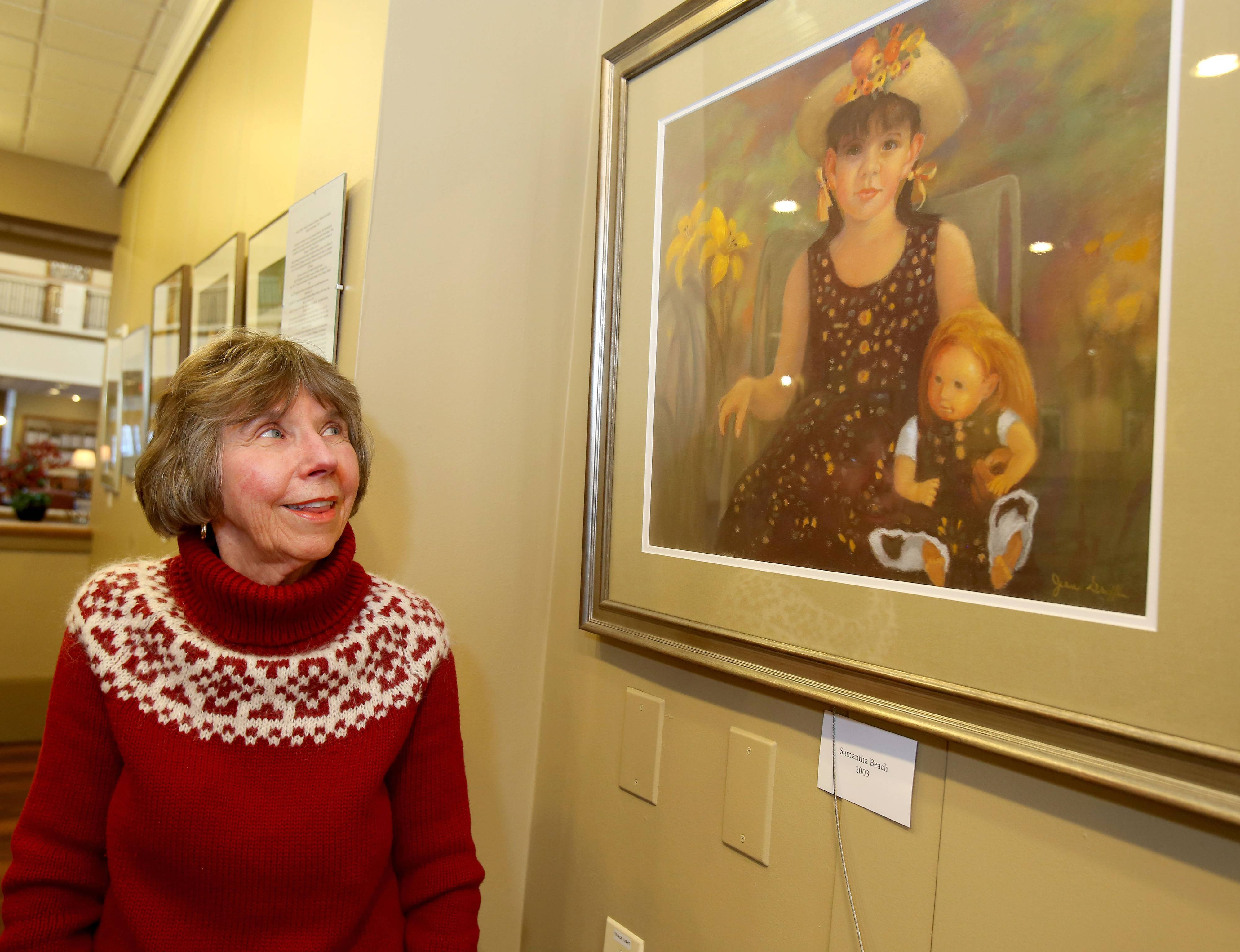 This girl with a doll is one of the portraits Glen Ellyn artist Jean Griffin has hanging at the Windsor Park retirement community in Carol Stream during February.