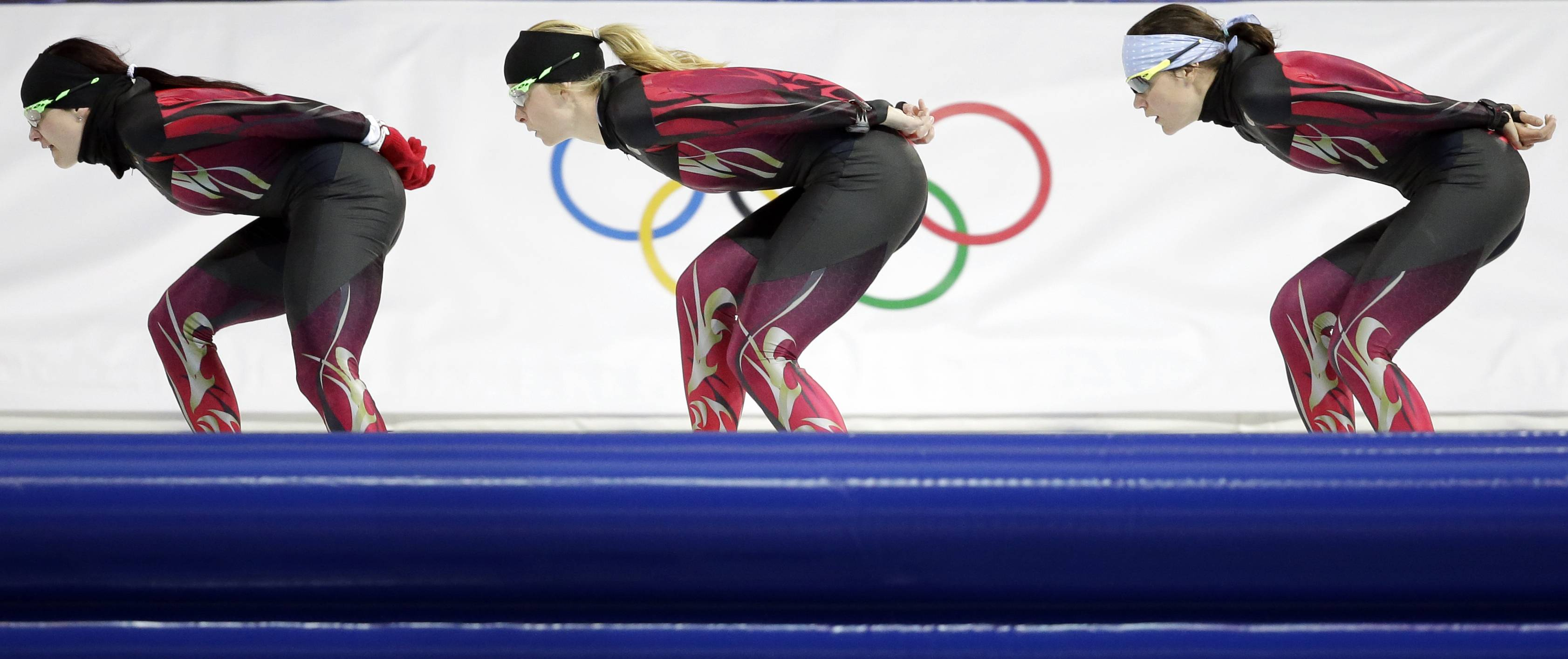 Germany's Judith Hesse, left, Stephanie Beckert, center, and Gabriele Hirschbichler train at the Adler Arena Skating Center during the 2014 Winter Olympics, Monday, Feb. 10, 2014, in Sochi, Russia.
