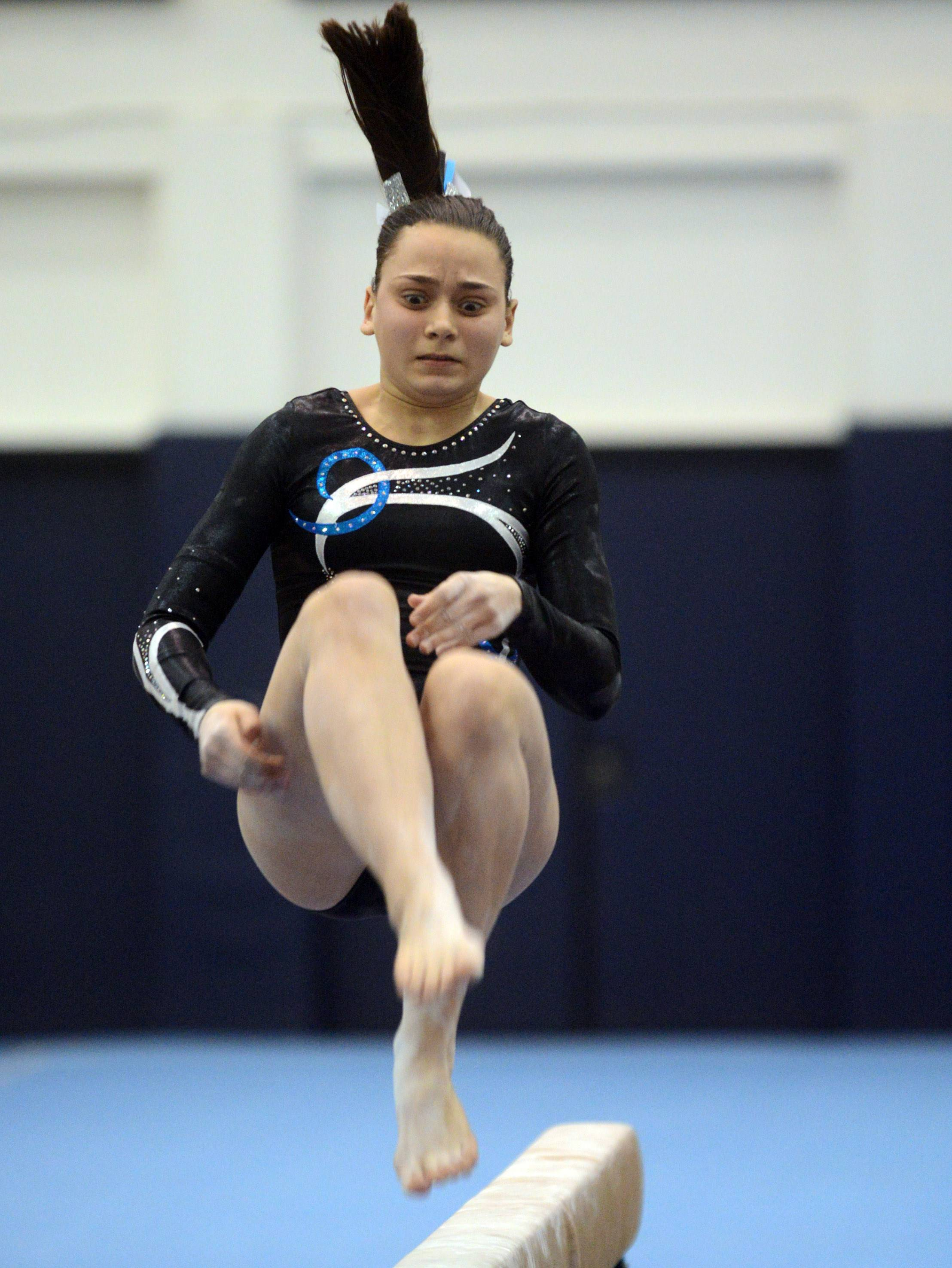 Prospect's Megan Donner competes on balance beam during the Conant sectional Monday night.