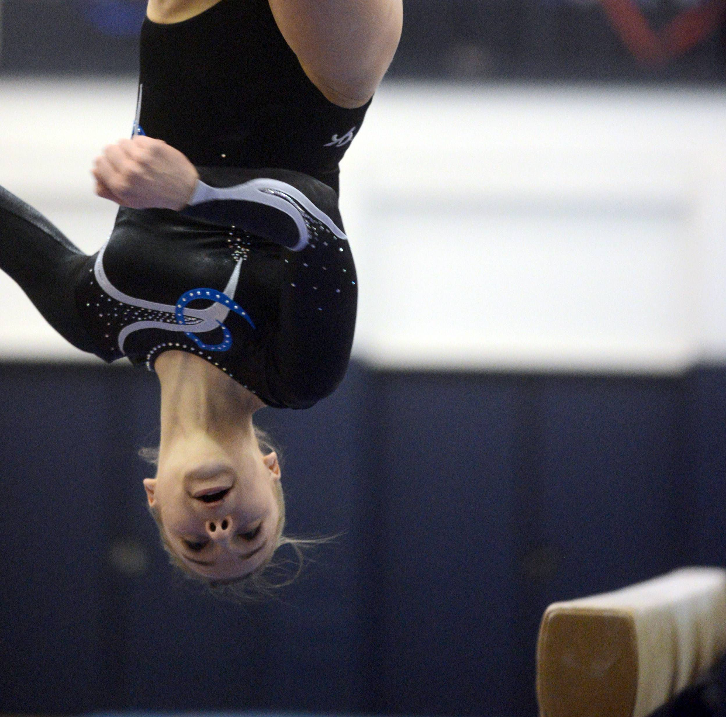 Prospect's Olivia Gonzalez competes on balance beam during the Conant sectional Monday night.