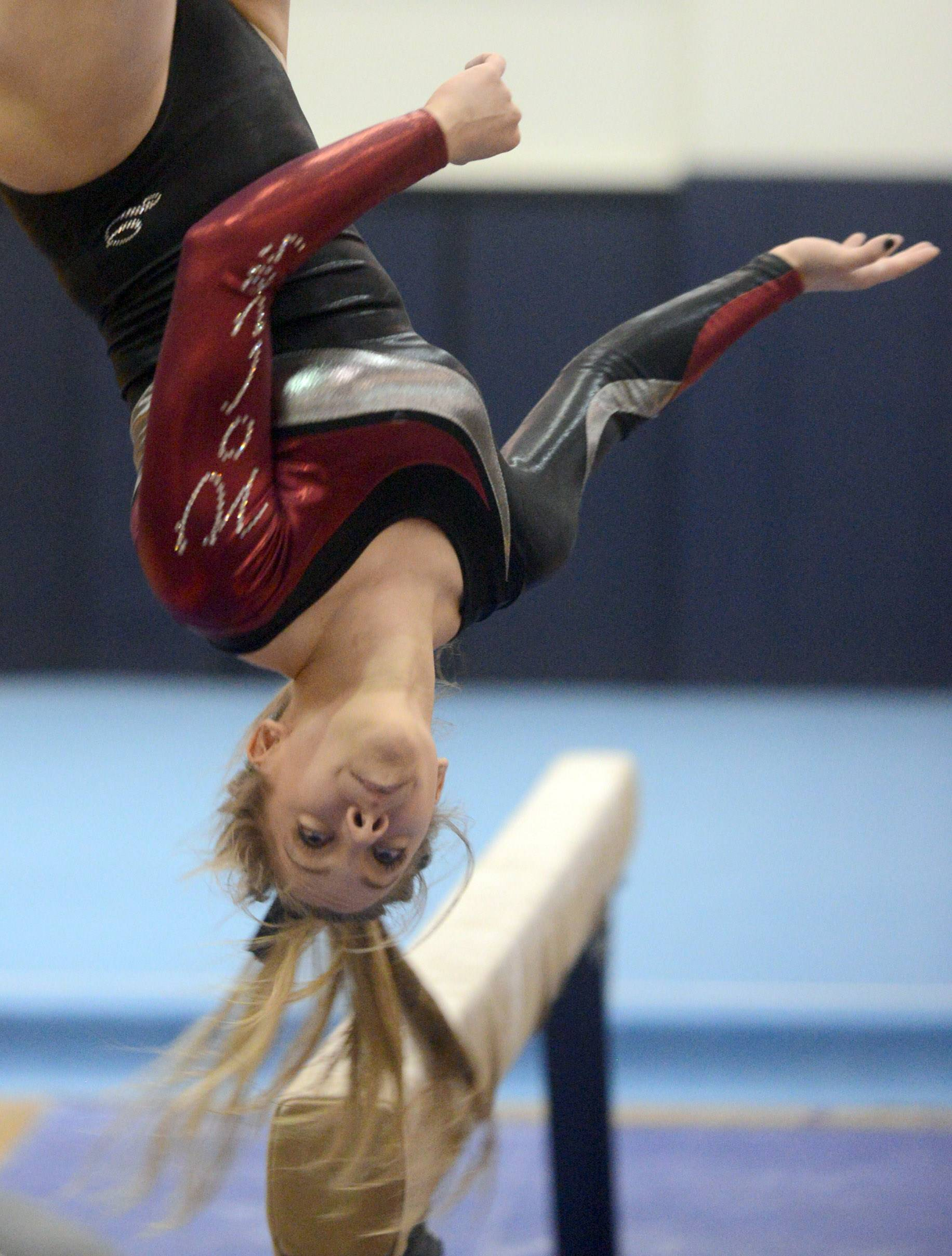 Prairie Ridge co-op's Maddie Solka competes on balance beam during the Conant sectional Monday night.