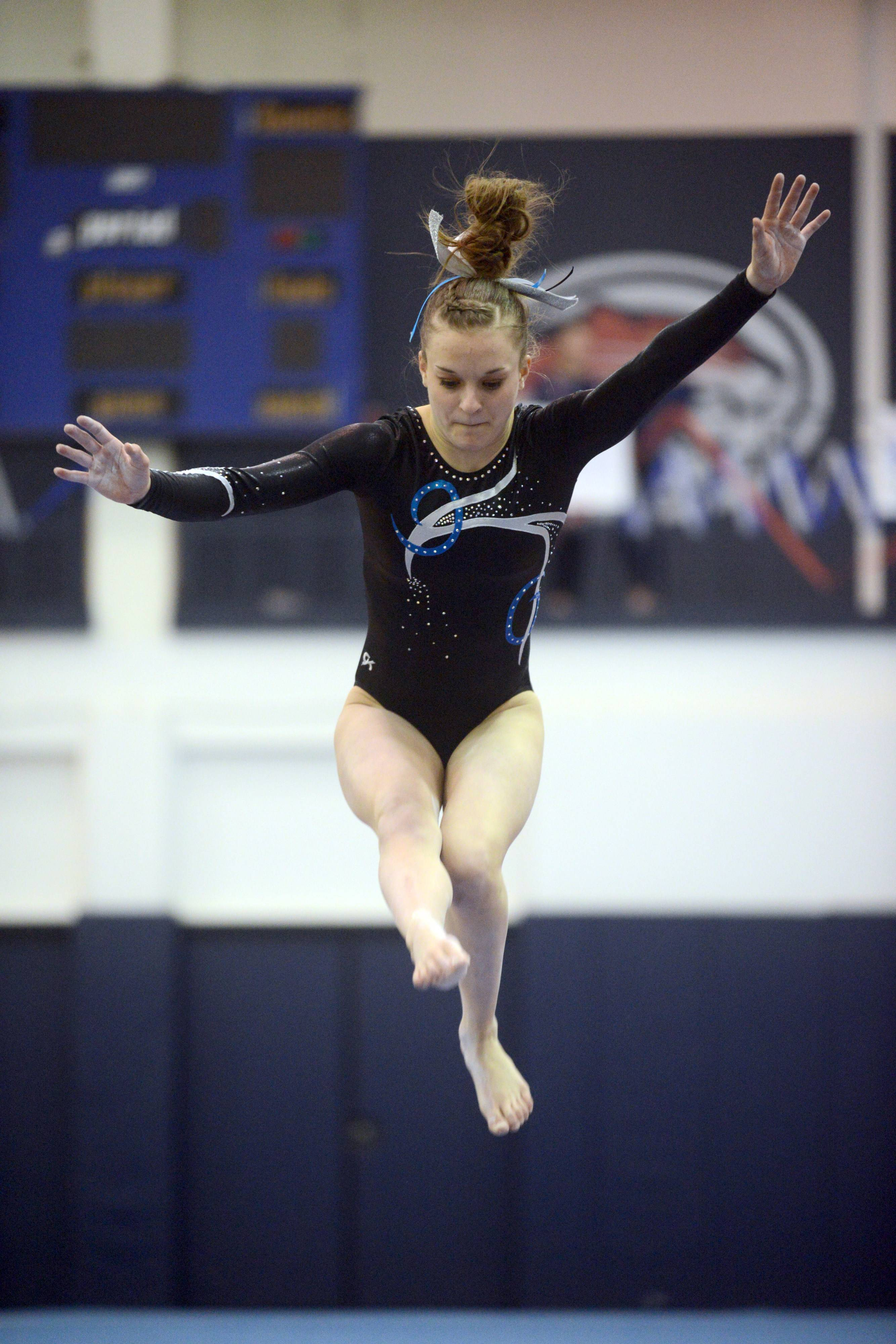 Prospect's Maddie Larock competes on balance beam during the Conant sectional Monday night.