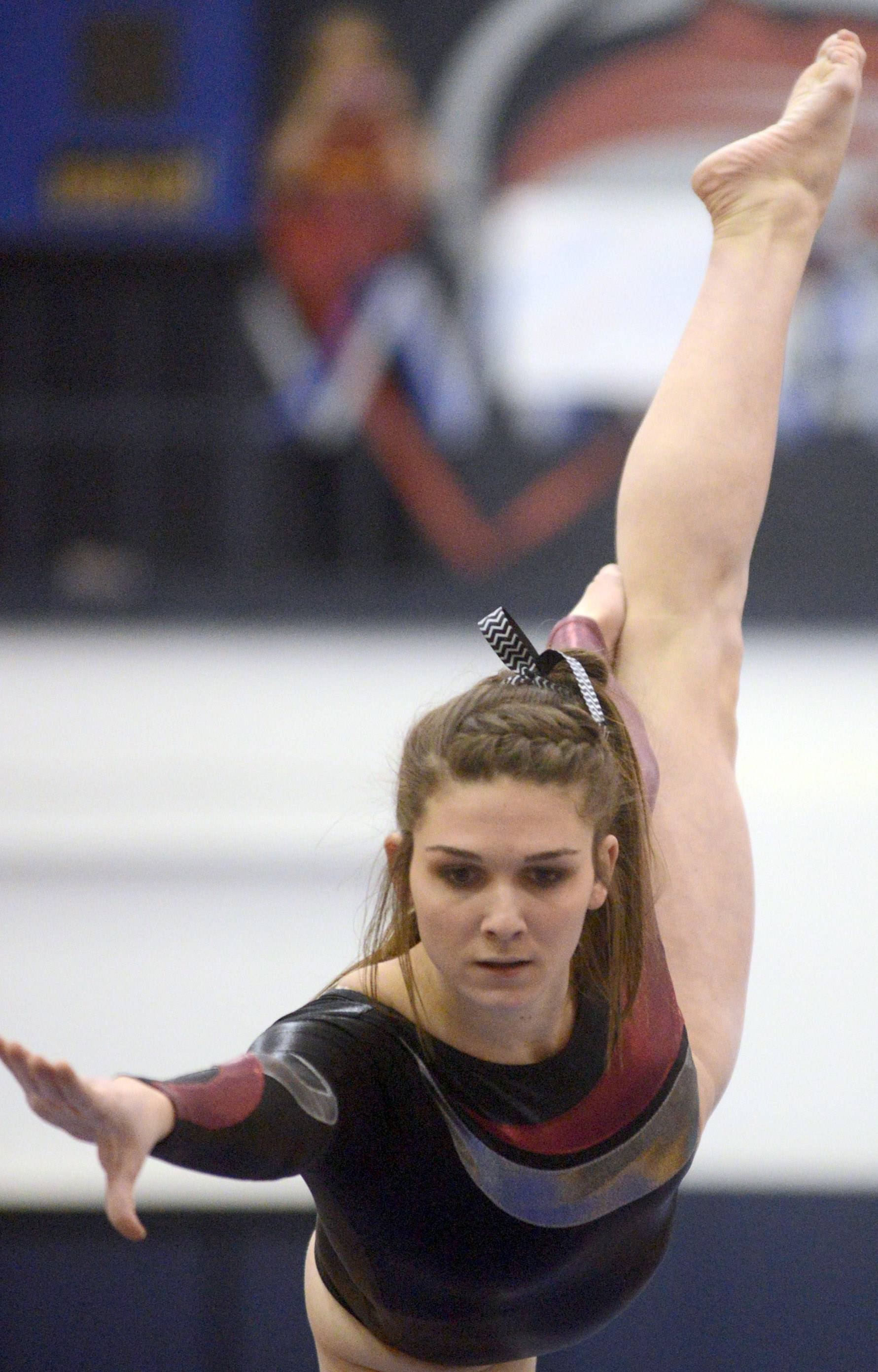 Prairie Ridge co-op's Rachael Underwood competes on balance beam during the Conant sectional Monday night.
