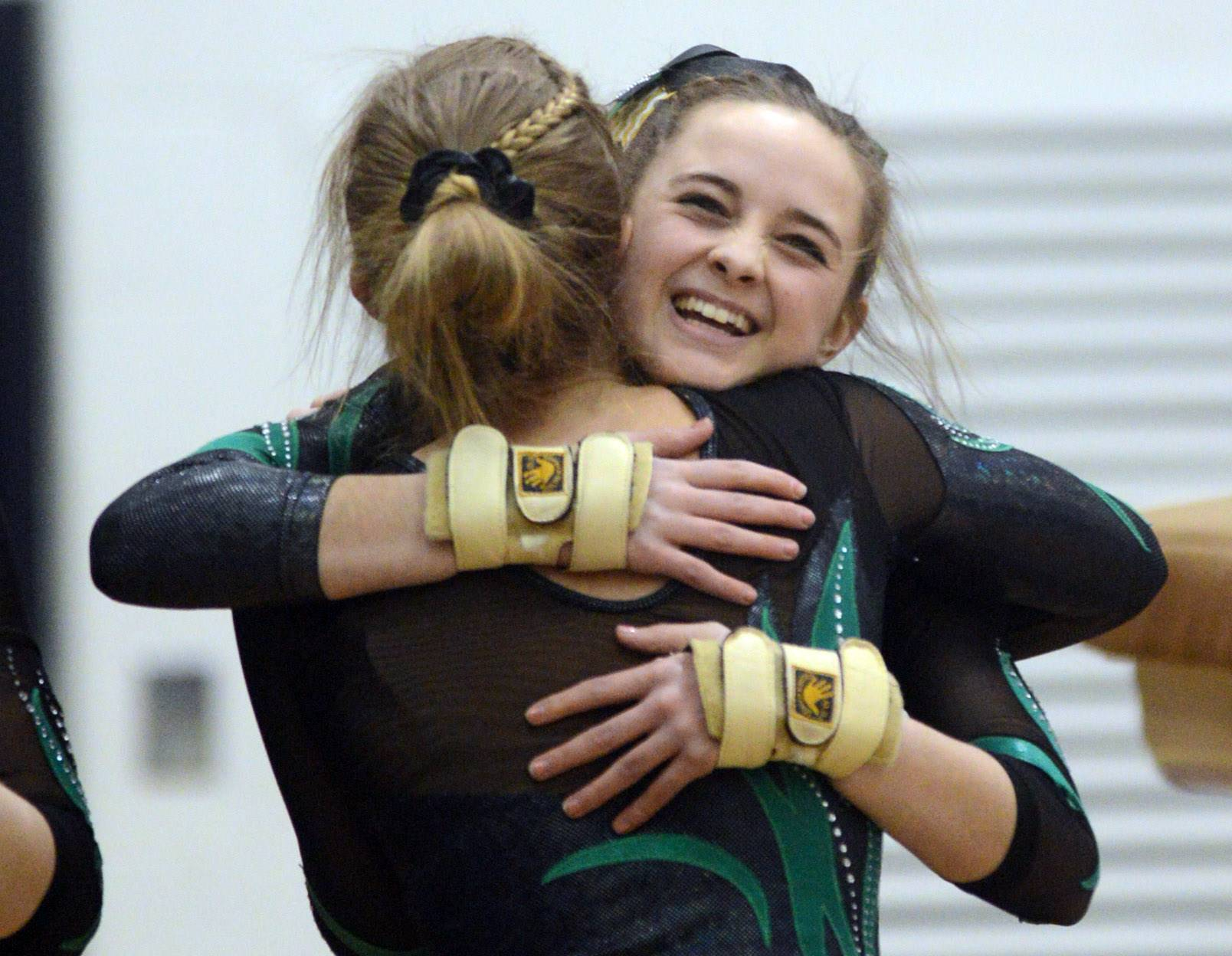 Fremd's Carly DeFilippo is congratulated after her vault during the Conant sectional Monday night.