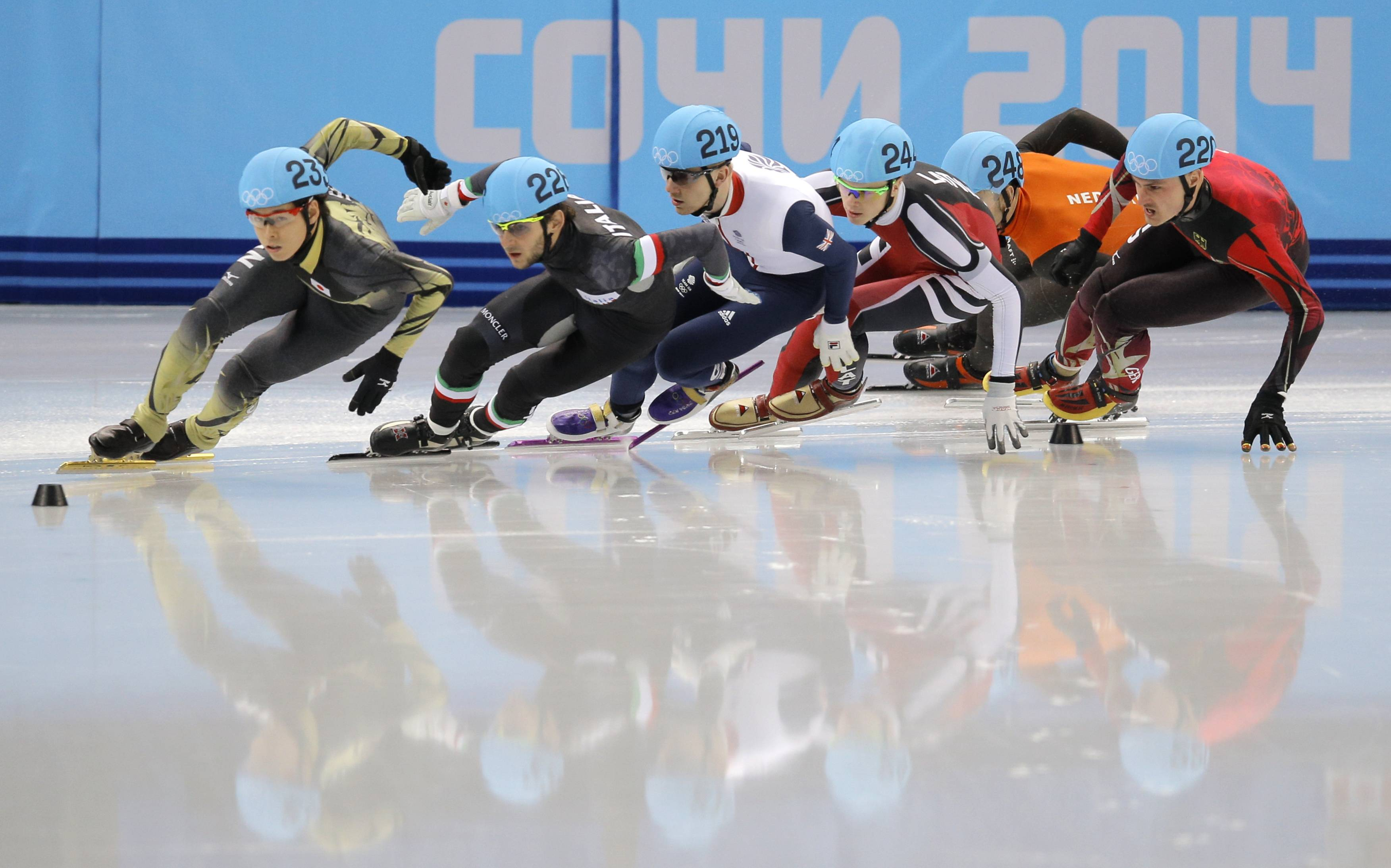 From left, Yuzo Takamido of Japan, Yuri Confortola of Italy, Jack Whelbourne of Britain, Roberto Pukitis of Latvia, Sjinkie Knegt of Netherlands, and Robert Seifert of Germany compete in a men's 1500m short track speedskating.